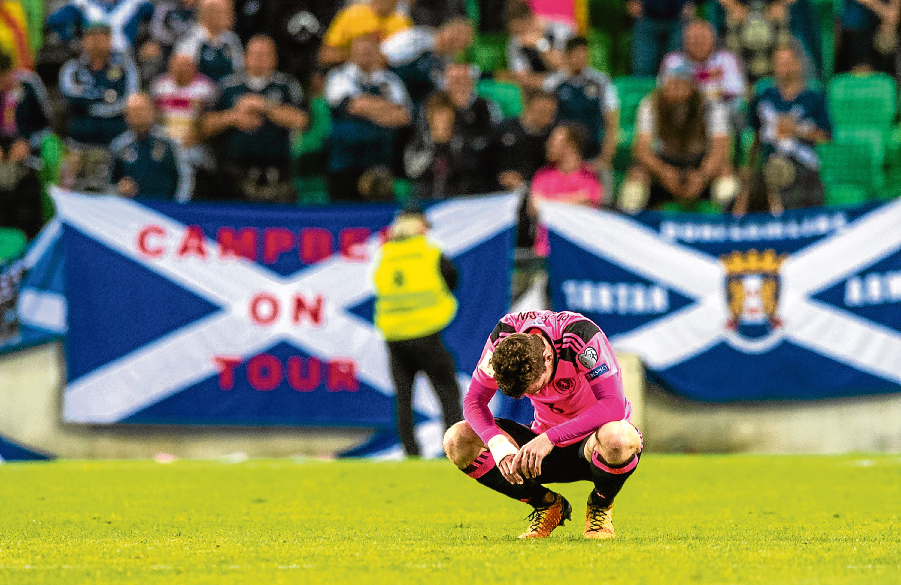 Dejection for Scotland's Andrew Robertson (SNS)