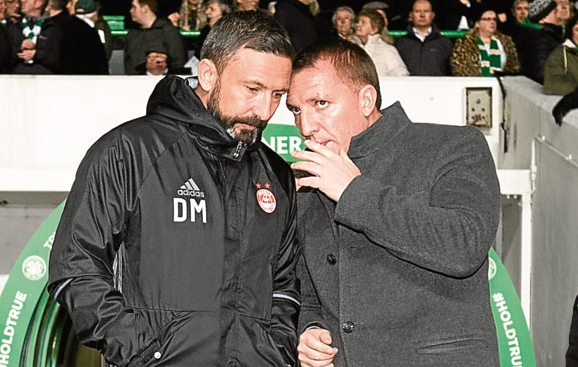 Aberdeen manager Derek McInnes (left) and Celtic boss Brendan Rodgers share some words on the touchline (SNS Group)