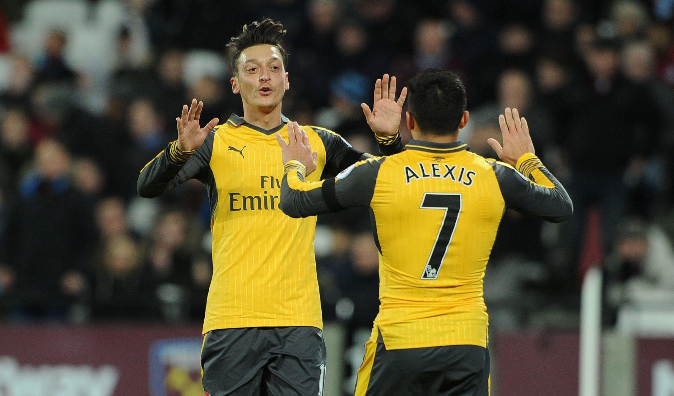 Mesut Ozil celebrates scoring  with Alexis Sanchez (David Price/Arsenal FC via Getty Images)