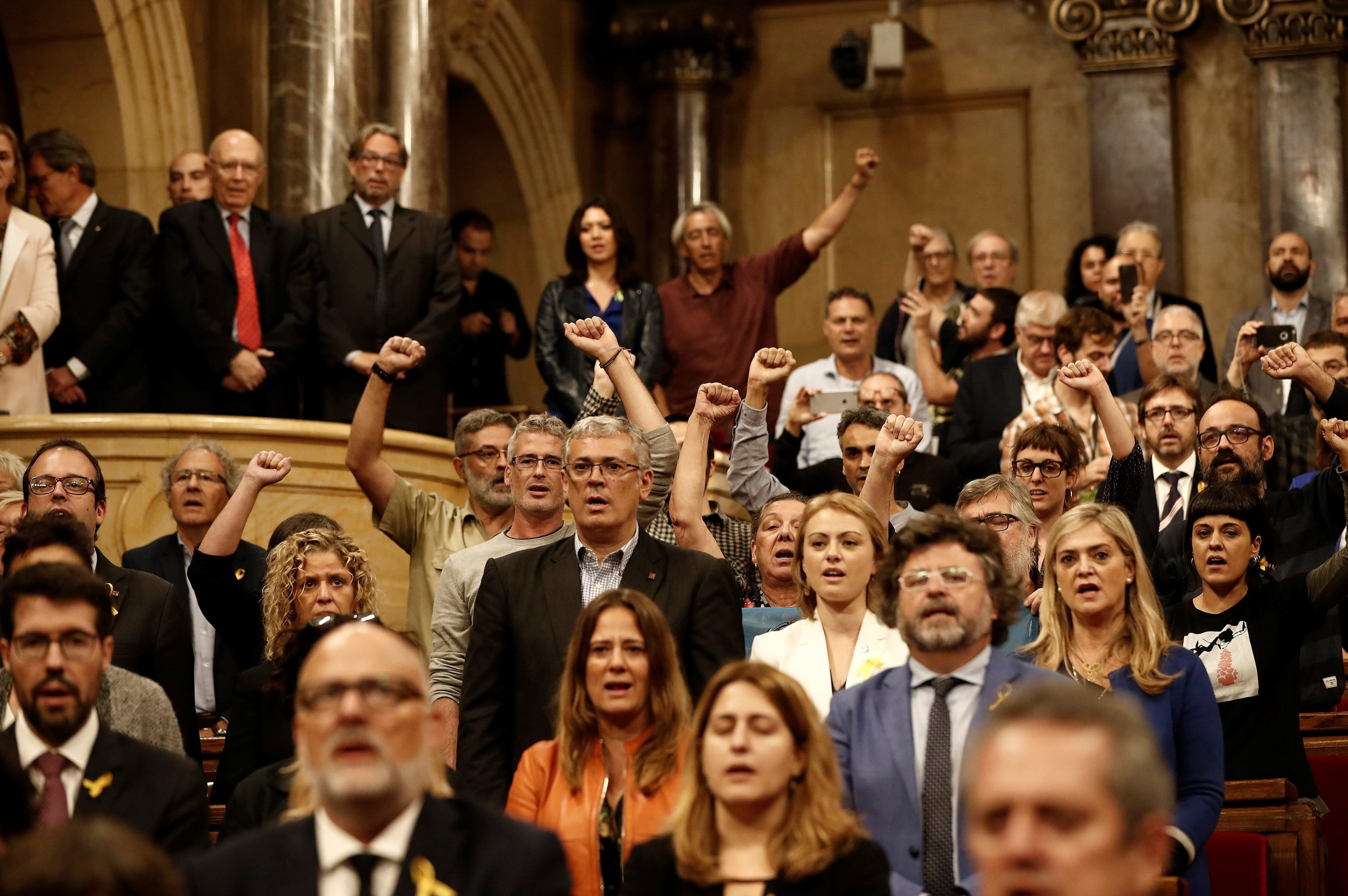 Deputies of Catalonian Parliament, who support the independence of Catalonia, shout slogans after Catalonian Parliament declared independence  (Burak Akbulut/Anadolu Agency/Getty Images)