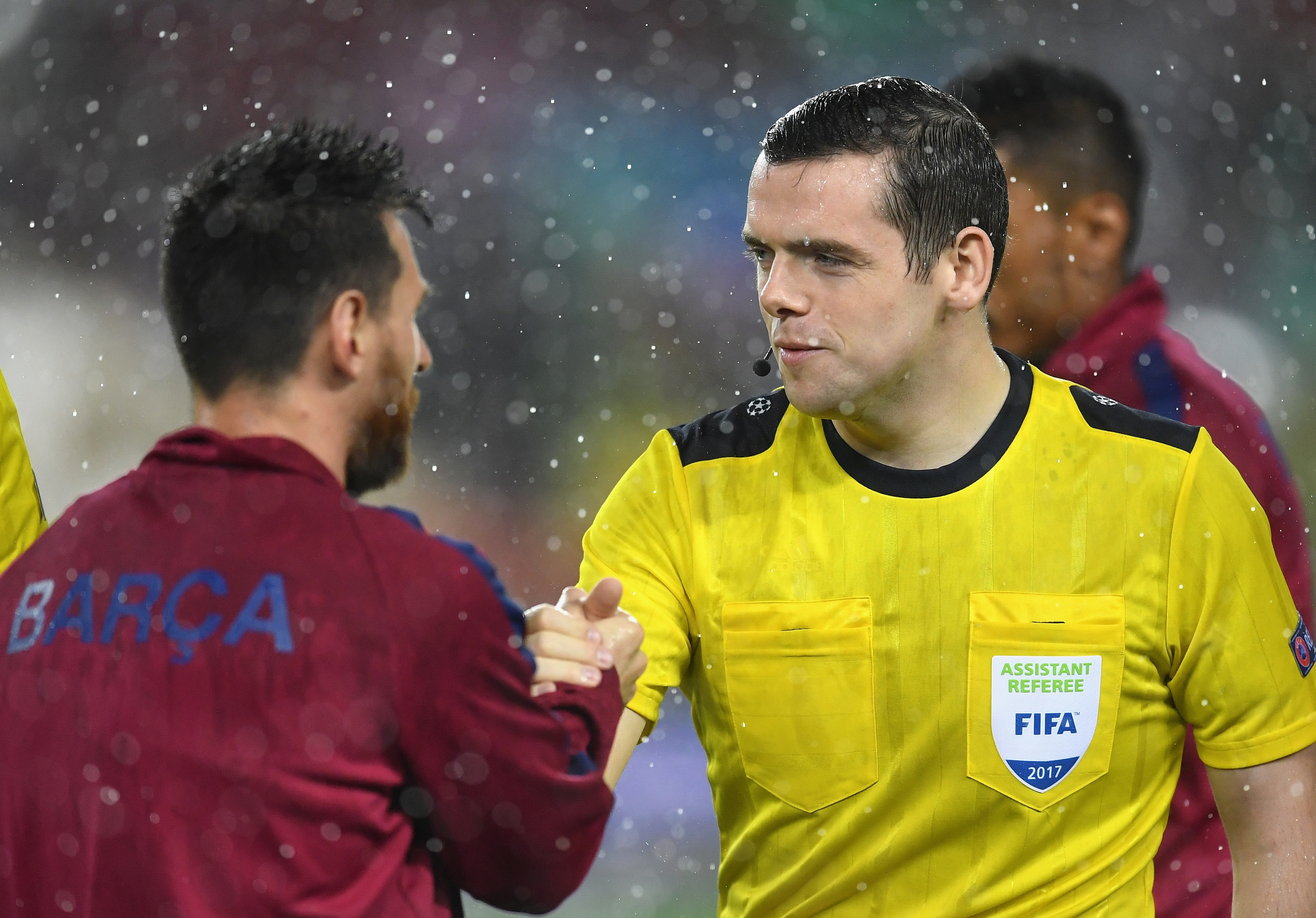 Assistant referee Douglas Ross  shakes hands with Lionel Messi after the Champions League match between Barcelona and Olympiakos Piraeus (David Ramos/Getty Images)