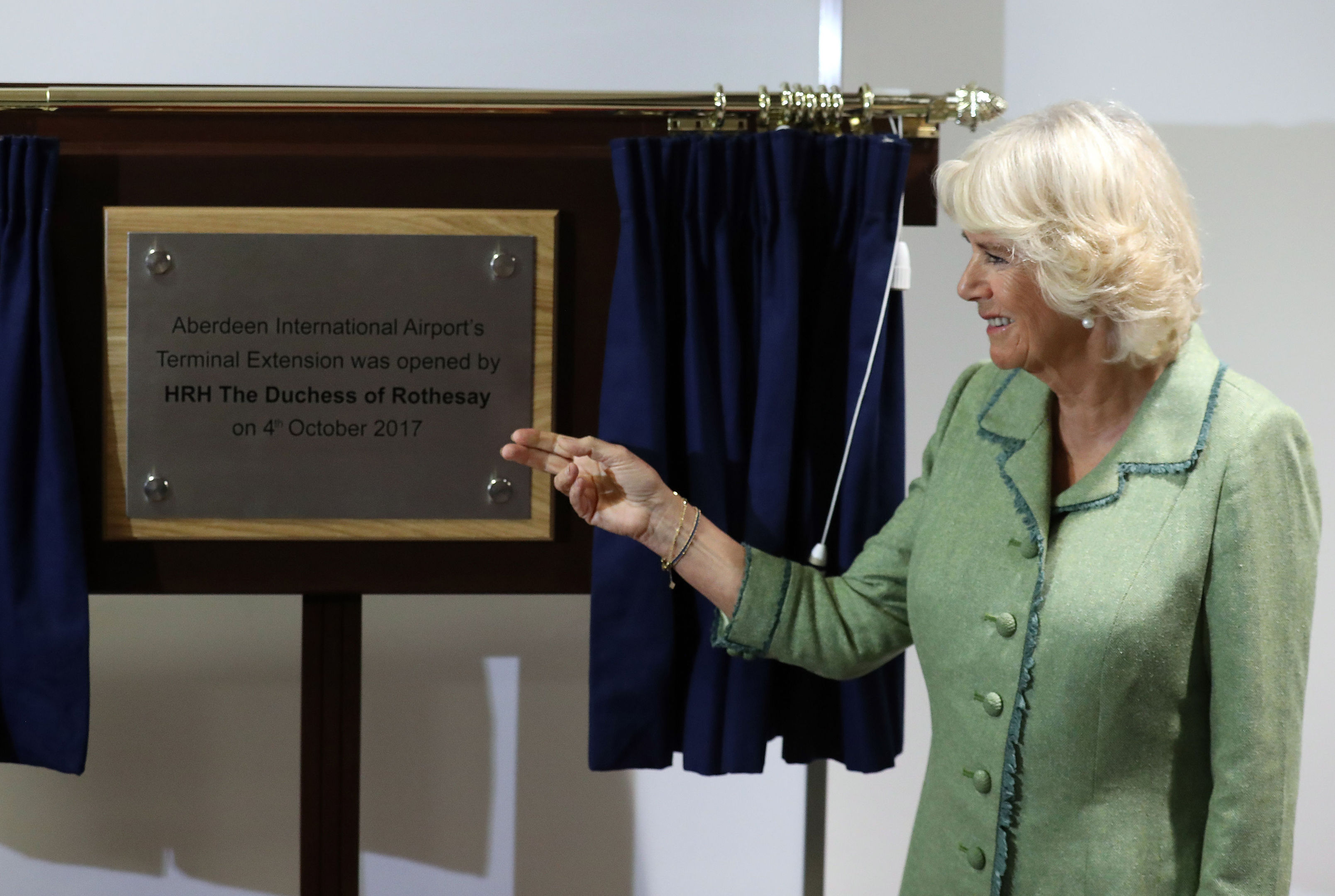Duchess of Cornwall (known as the Duchess of Rothesay while in Scotland) unveils a plaque whilst opening a new extension to Aberdeen International Airport. (Andrew Milligan/PA Wire)