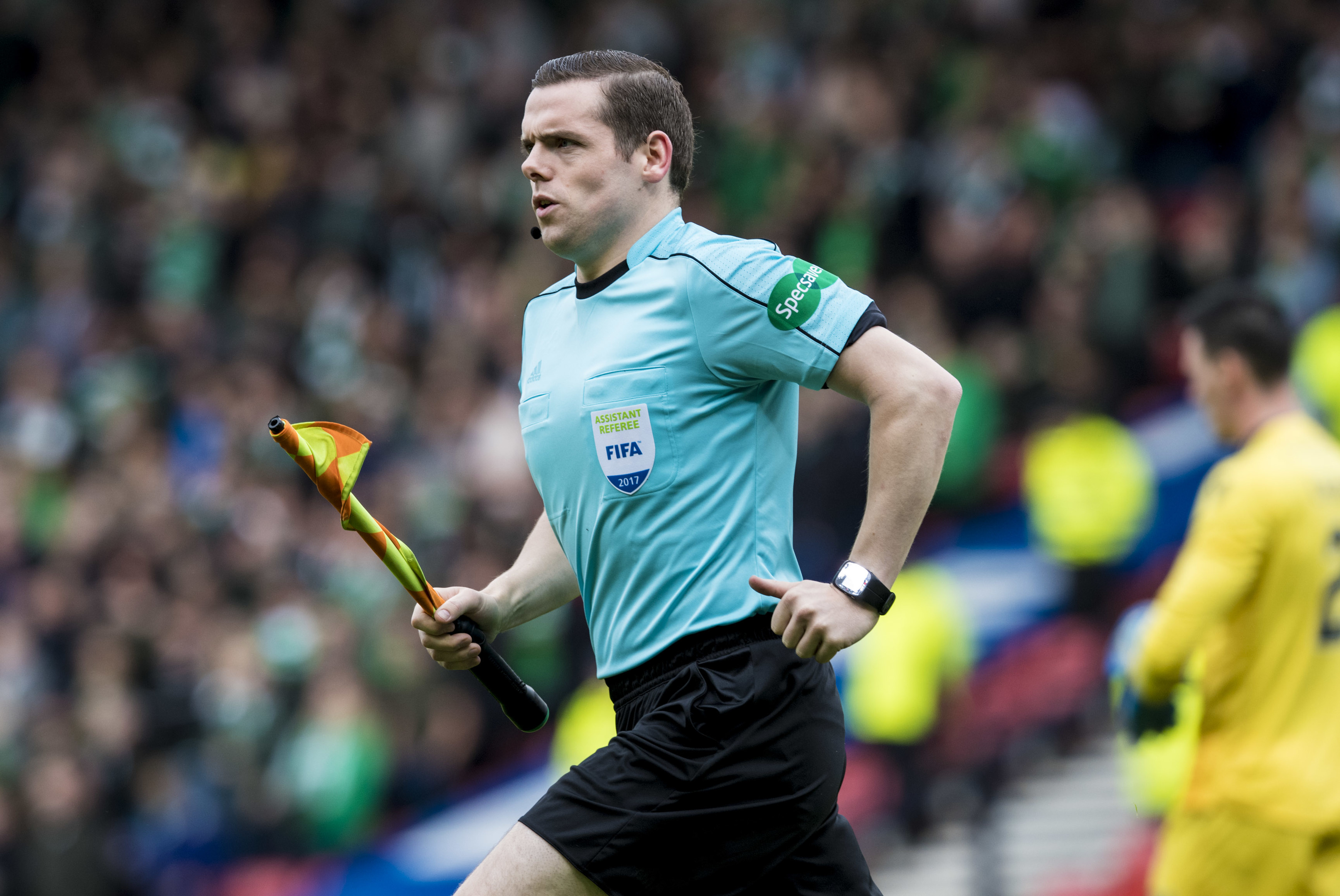 Conservative MP Douglas Ross running the line at yesterday's Hibs v Celtic match (SNS Group)