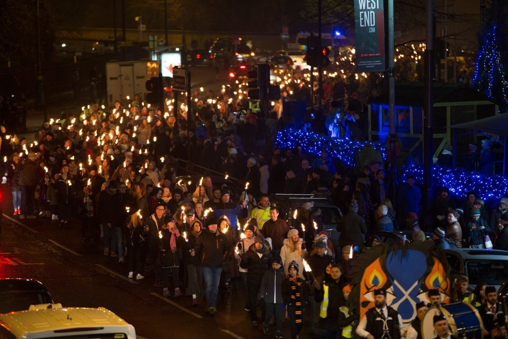 West End Festival Winter Torchlight Parade for St Andrews Day, walking down Byres Rd (Martin Shields)