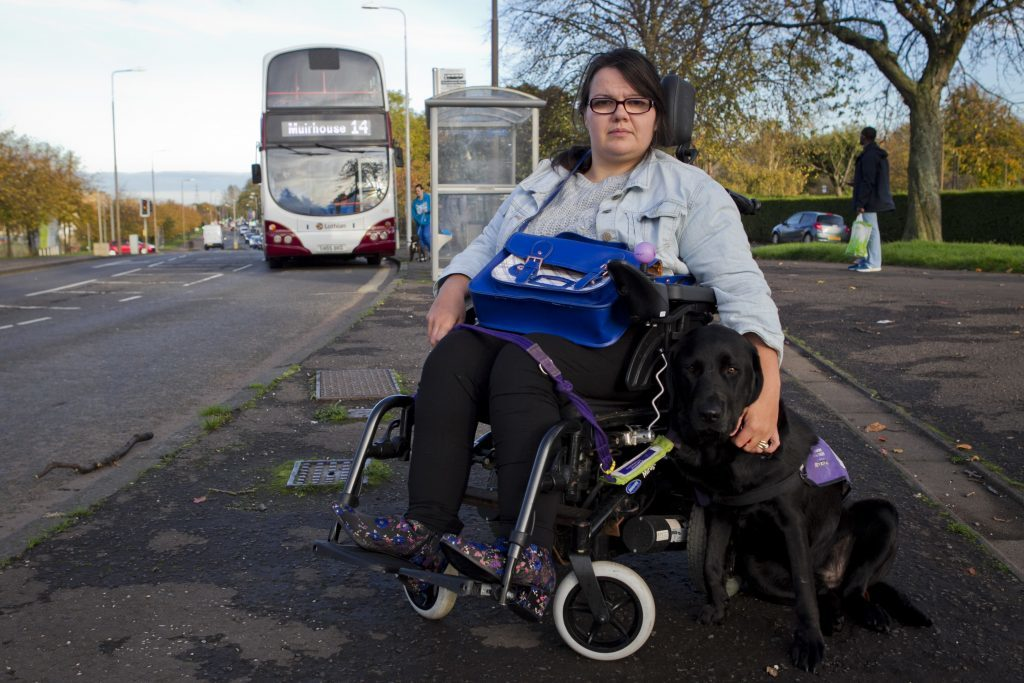 Karen Sutherland (and dog Wilf). She has had trouble getting on buses, when buses are full and a pram is blocking her getting on. (Andrew Cawley, DC Thomson)