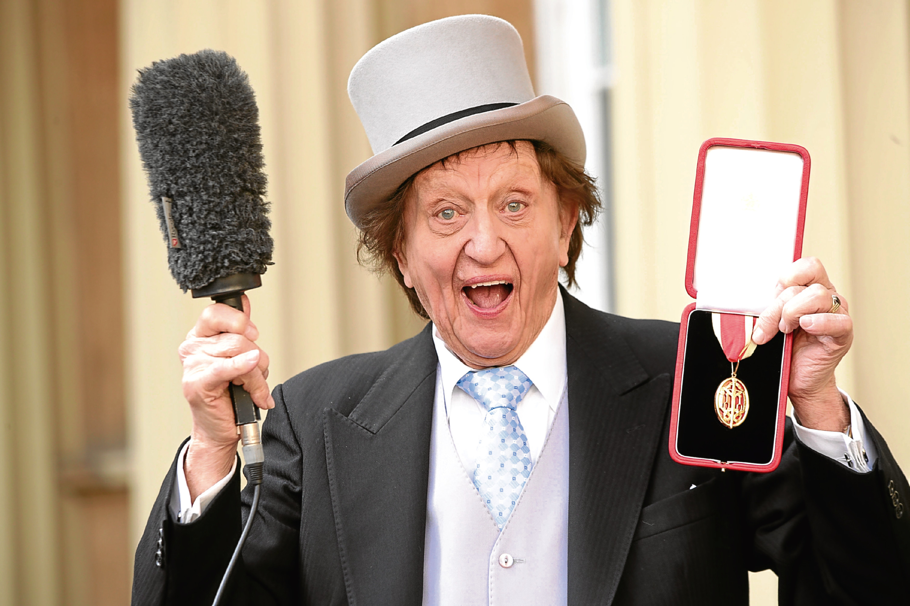 Ken Dodd was thrilled to receive his knighthood earlier this year (Yui Mok / PA)