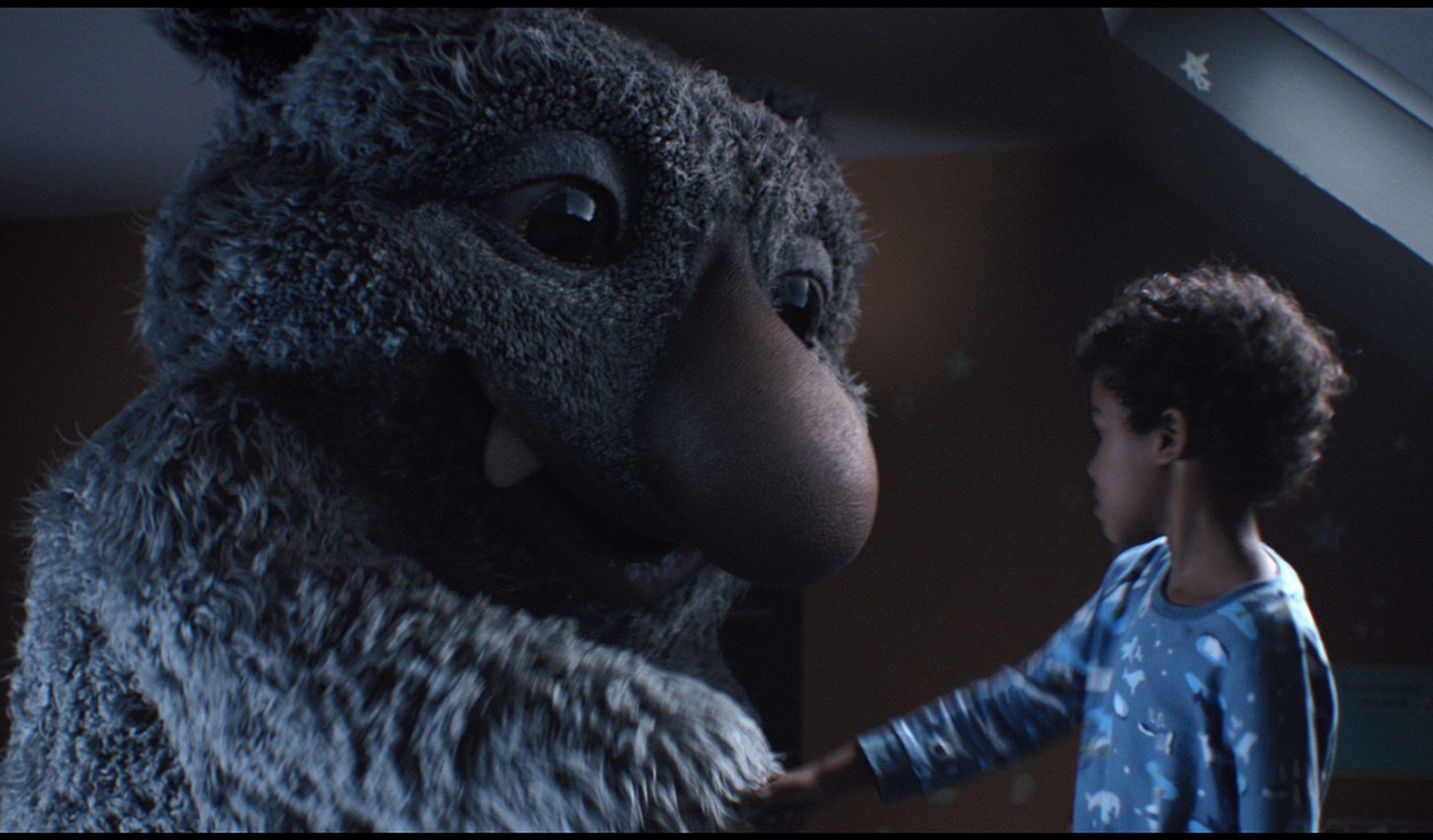 'Moz the Monster' and his seven-year-old host Joe are the stars of the new ad (John Lewis/PA Wire)