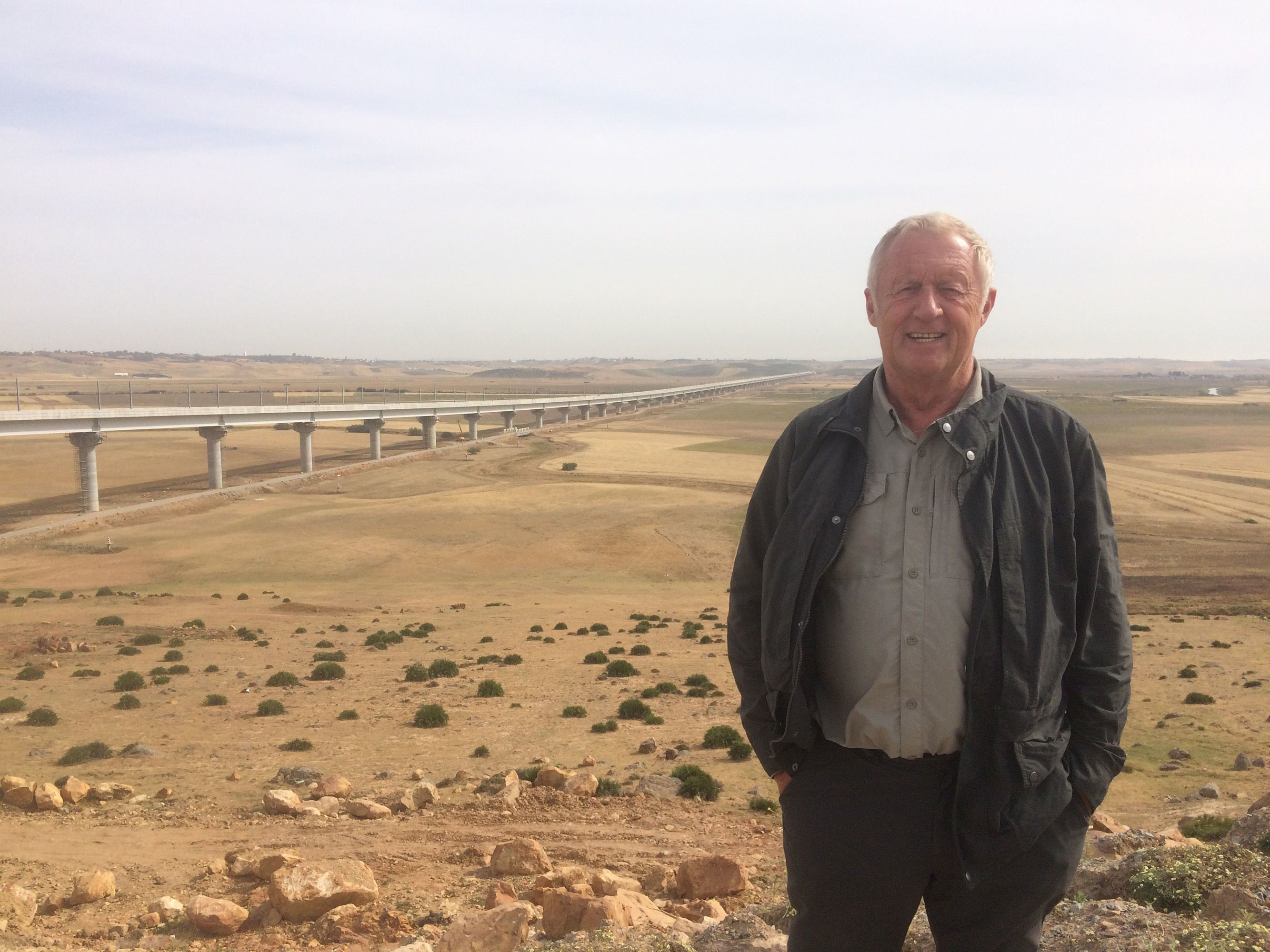 Chris standing in front of 200 million pound Faisal Bridge, Morocco