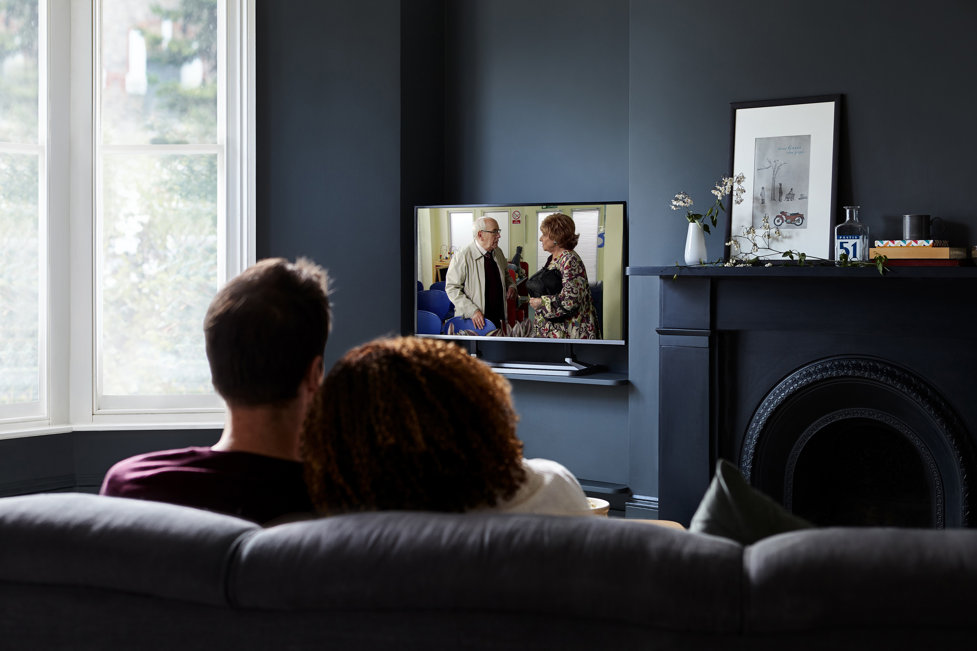 A couple enjoy watching Coronation Street, Scotland's favourite TV show, according to research by Freeview to celebrate its 15th anniversary