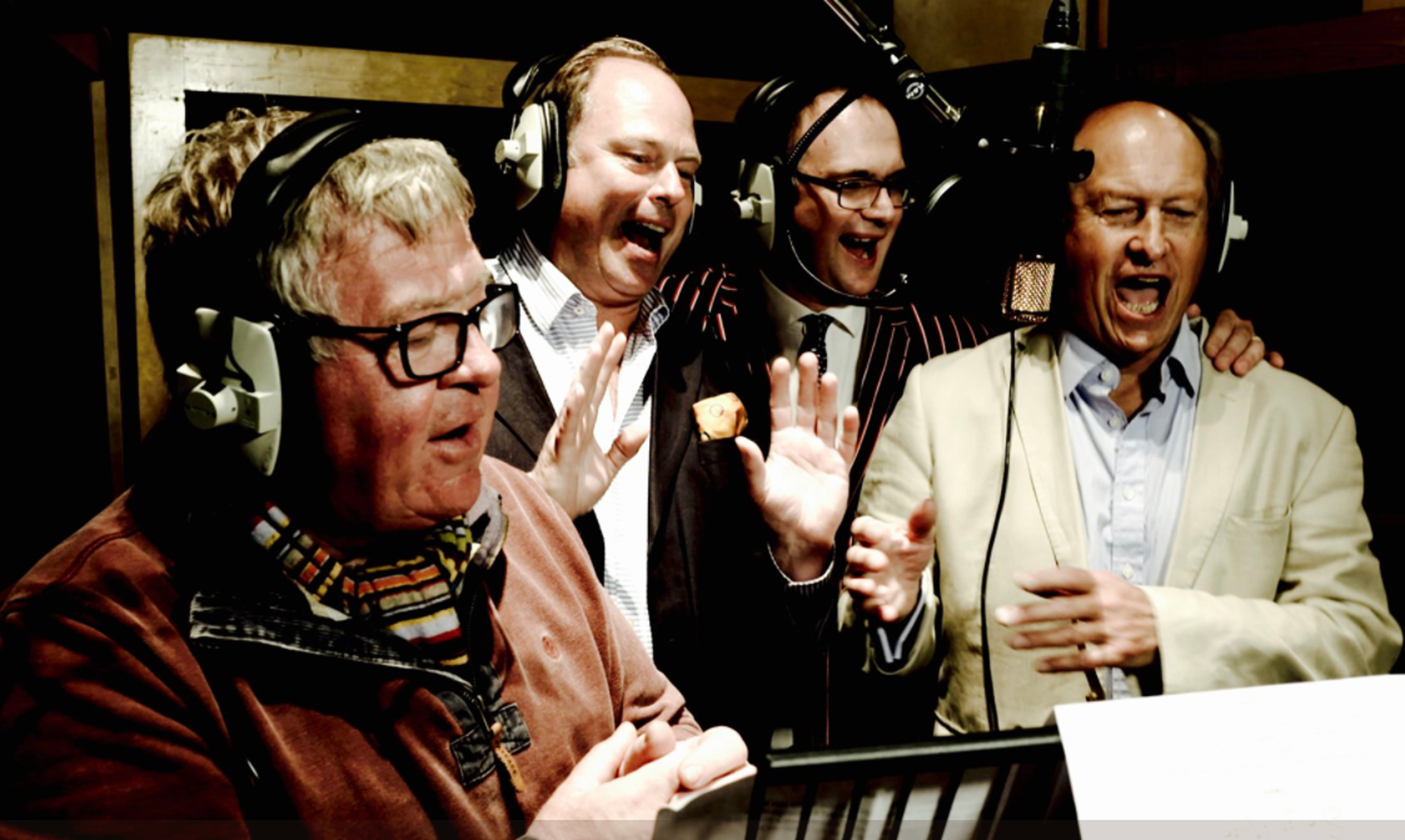 Television antiques experts Philip Serrell, James Braxton, Charles Hanson and Charlie Ross recording their charity Christmas single in a London recording studio. (Hansons Auctioneers/PA Wire)