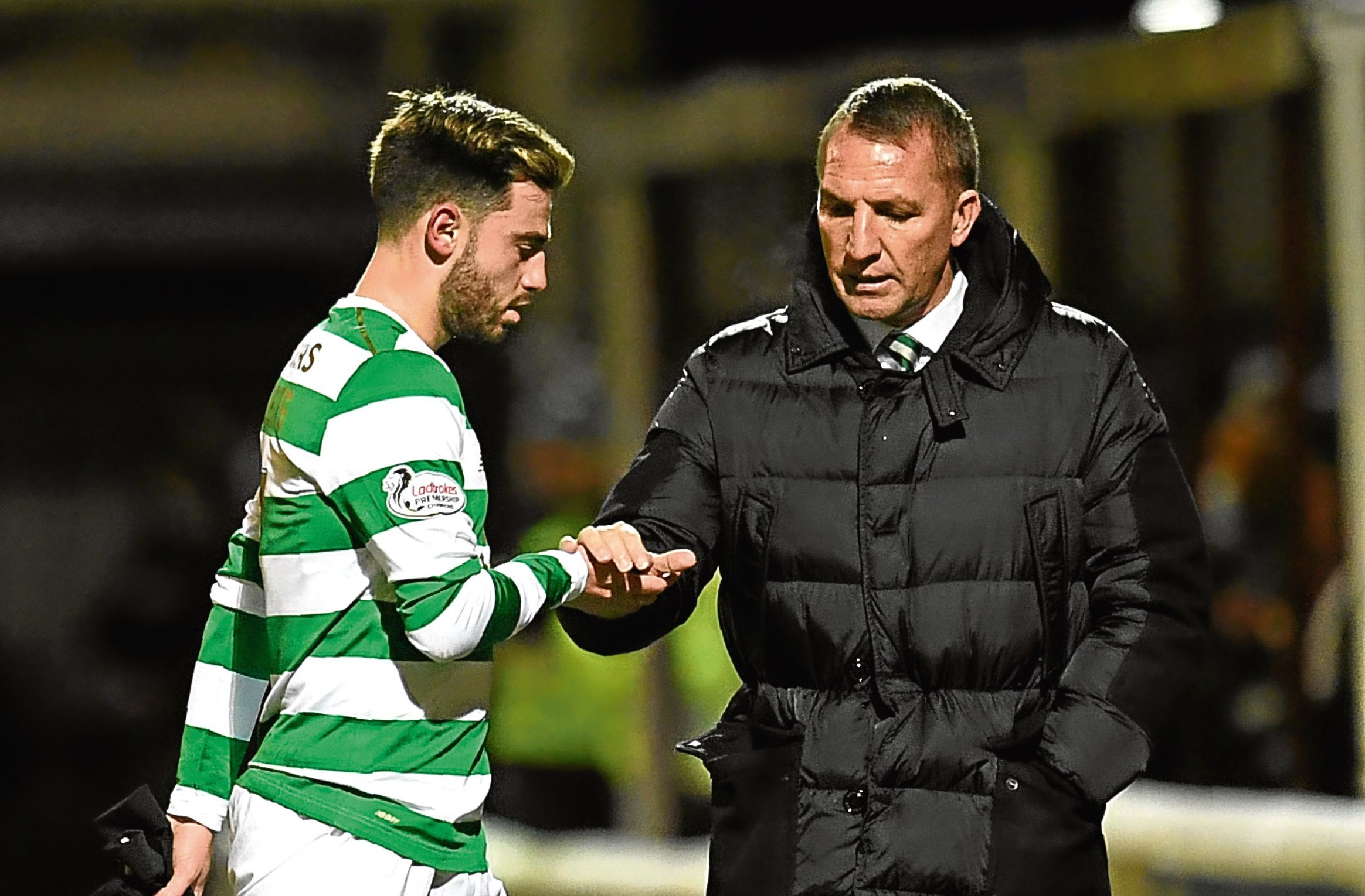 Celtic manager Brendan Rodgers consoles Patrick Roberts as he suffers an injury (SNS)