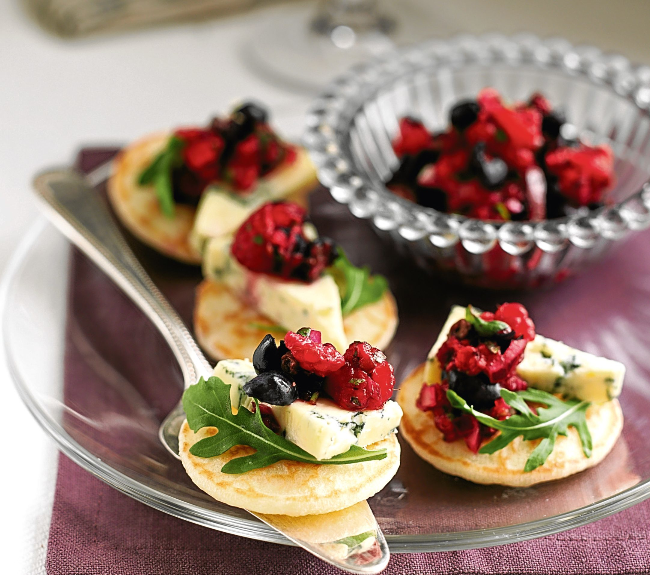 Stilton blinis with blueberry and raspberry salsa