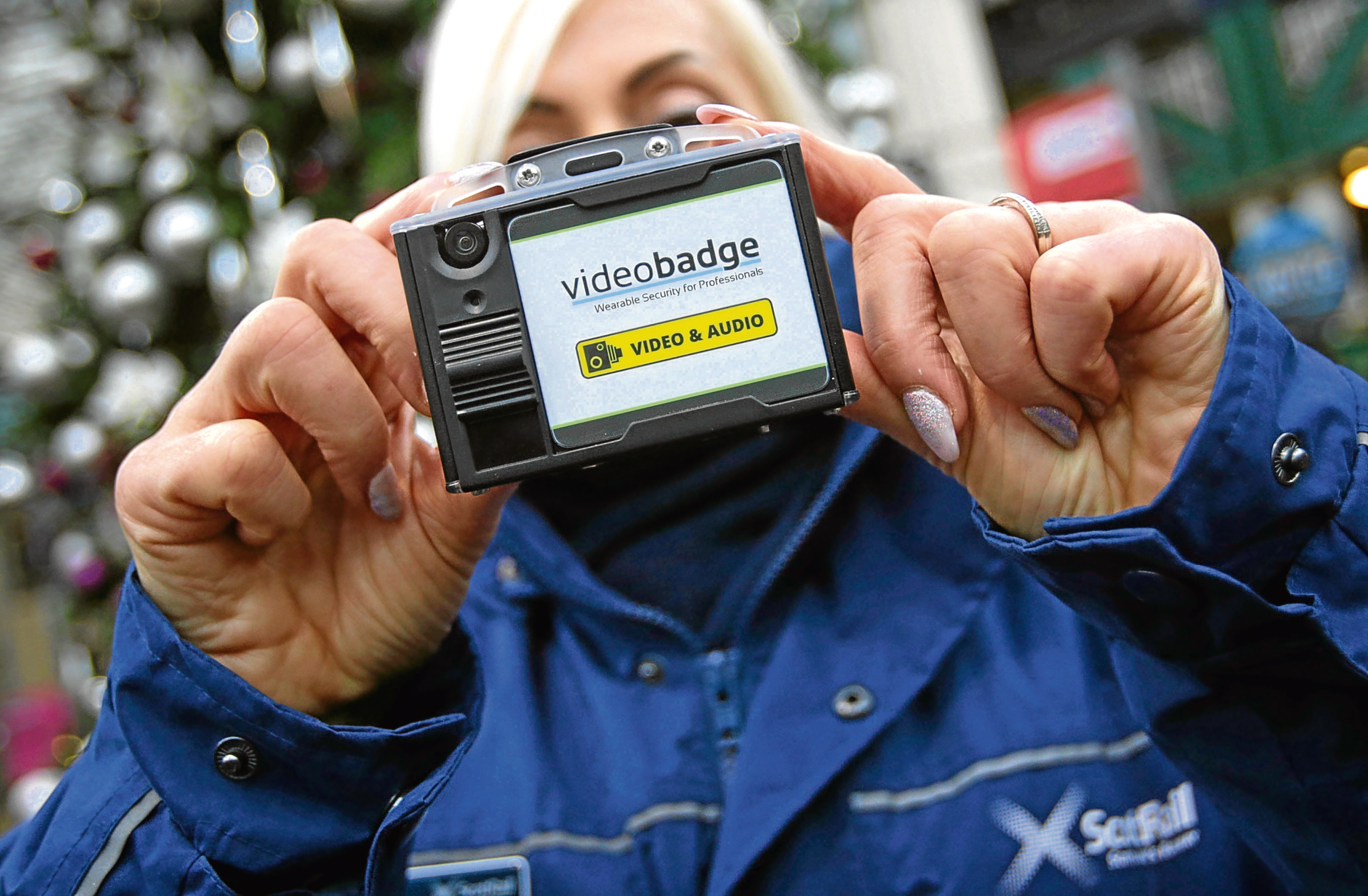 A member of ScotRail staff holds a new body-worn CCTV camera at Waverley Station, Edinburgh, as it was announced that staff are to carry them while on trains. (David Cheskin/PA Wire)