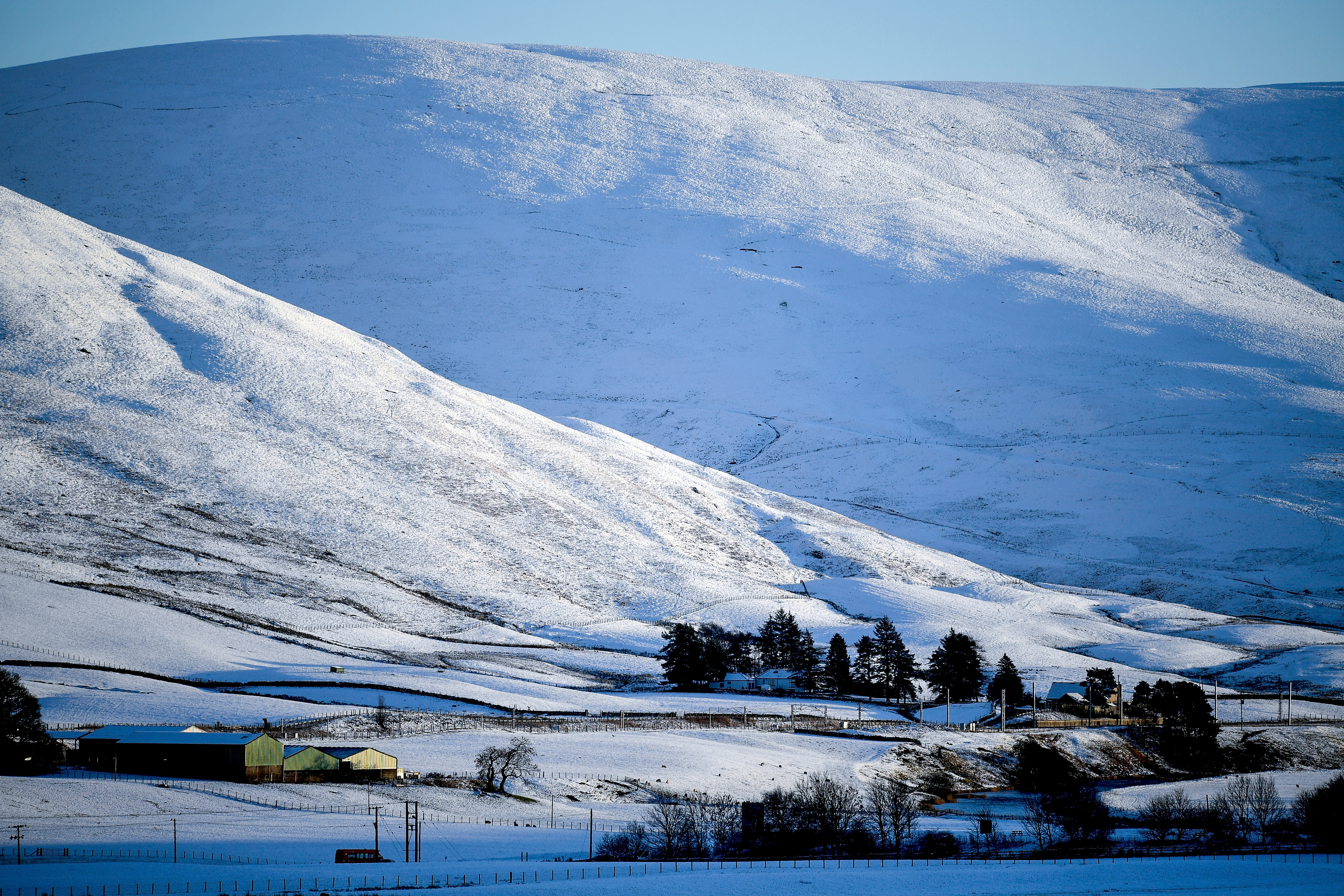 Snow covers a hill off the A73 as temperatures drop across the country (Jeff J Mitchell/Getty Images)