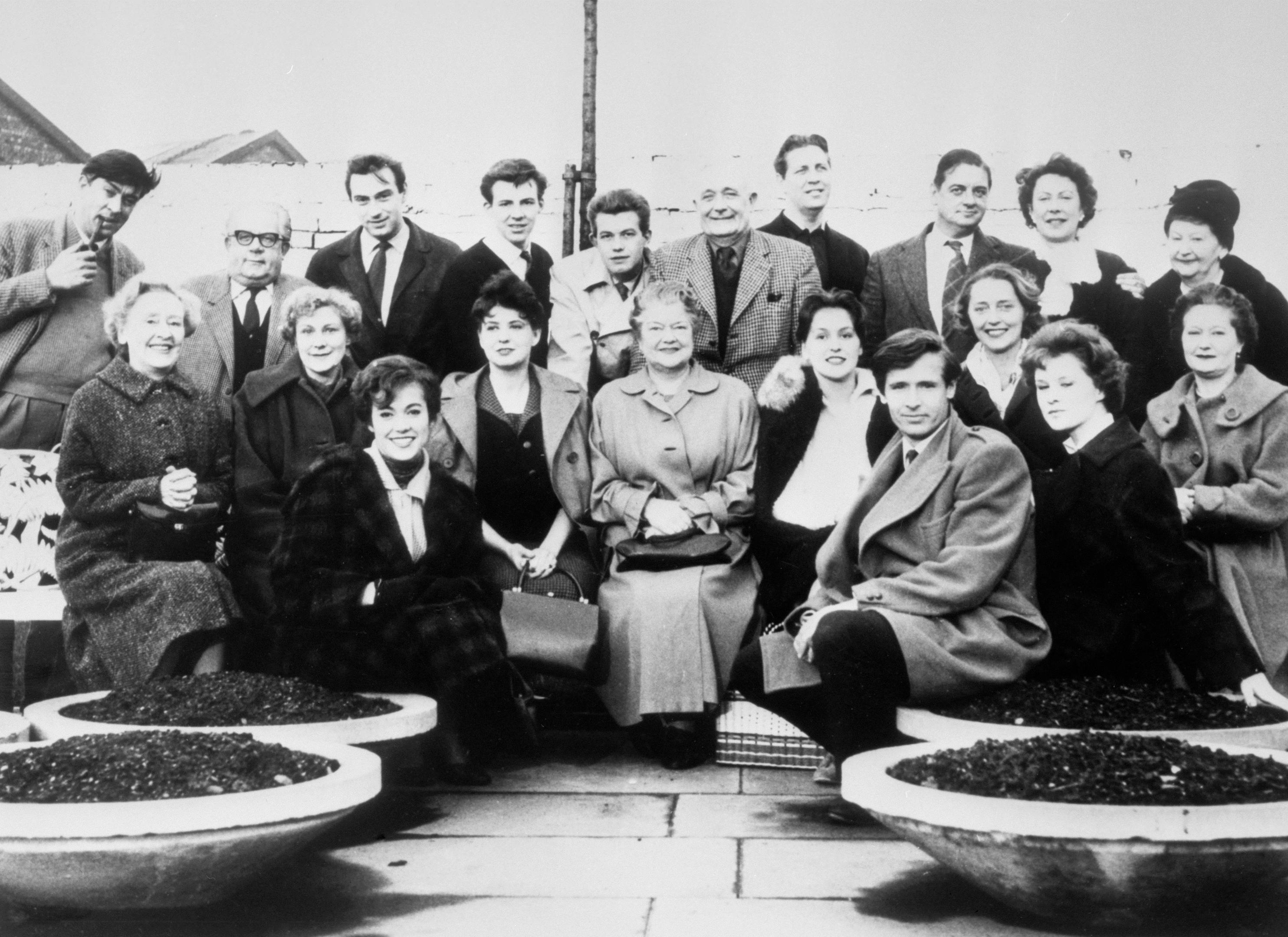 The cast of Coronation Street in the Granada TV Centre car park in Manchester, between rehearsals for the first programme networked on December 9, 1960 (PA Archive)