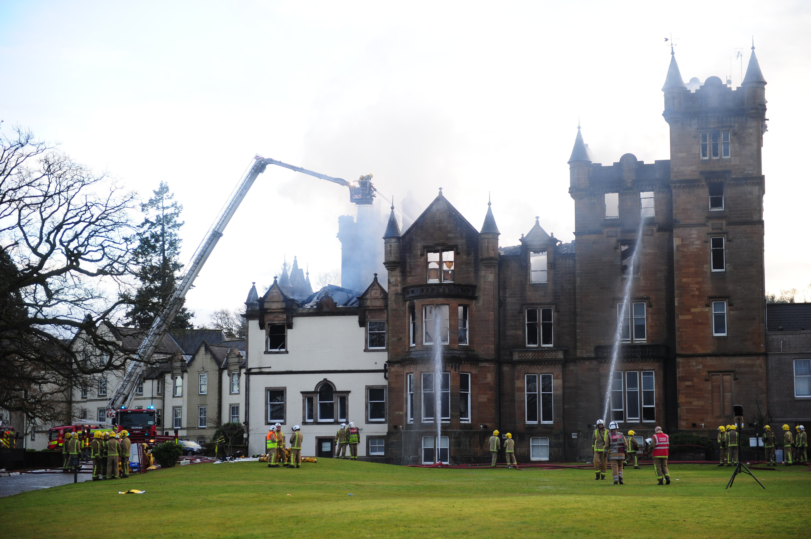 Firefighters at the scene following a fire at the Cameron House Hotel on the banks of Loch Lomond (Mike Gibbons/PA Wire)