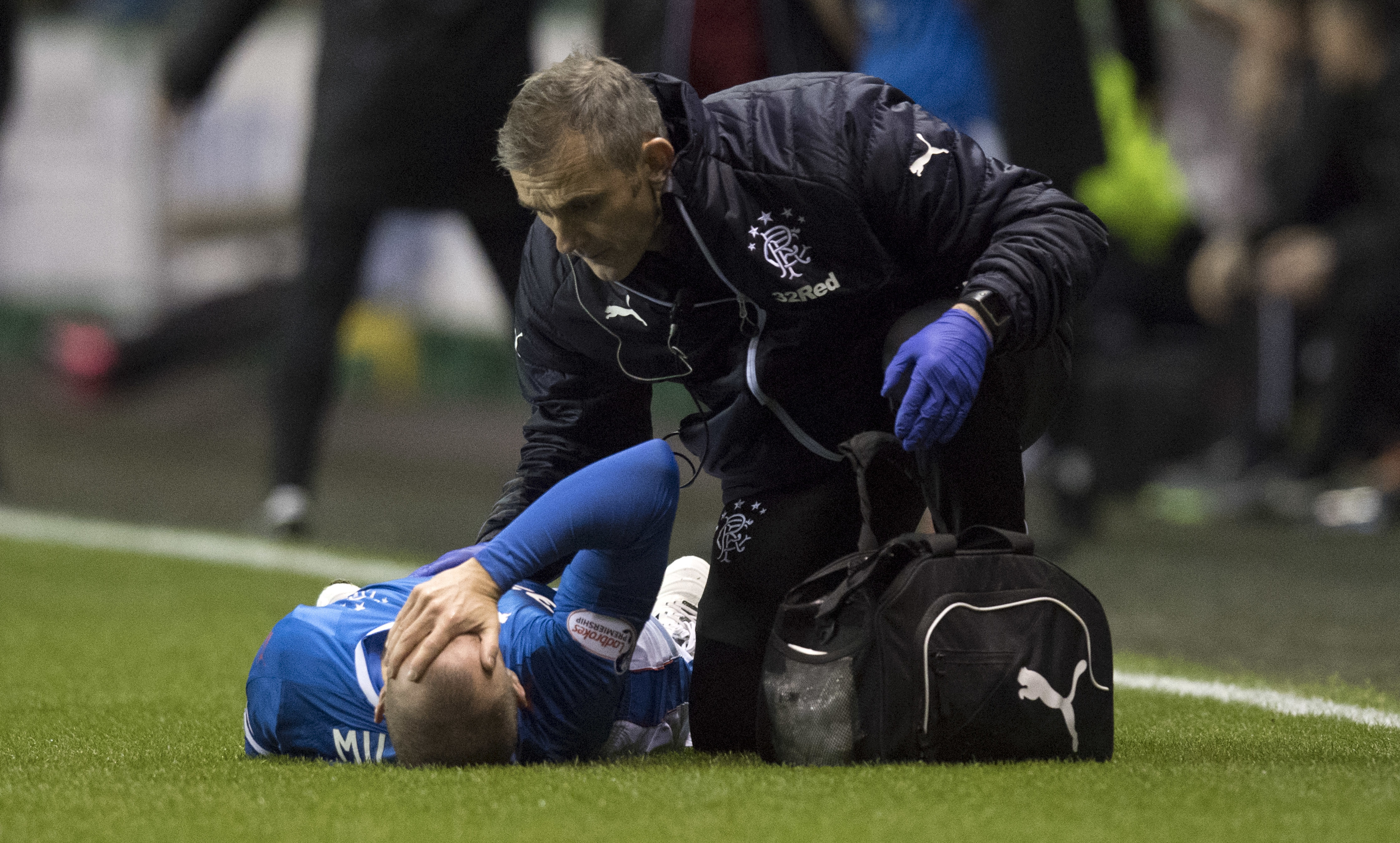 Rangers' Kenny Miller goes down with an injury at Easter Road (SNS Group)