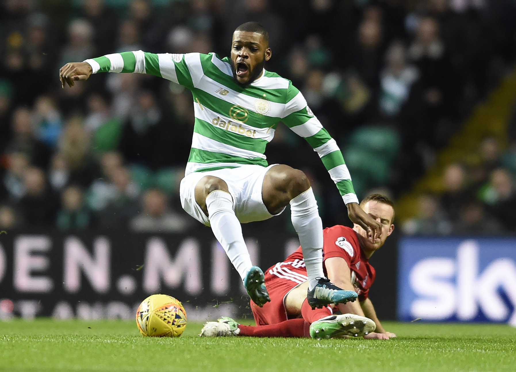 CelticÕs Olivier Ntcham (left) is brought down by AberdeenÕs Adam Rooney during the Scottish Premiership match at Celtic Park, Glasgow. (Ian Rutherford/PA Wire)