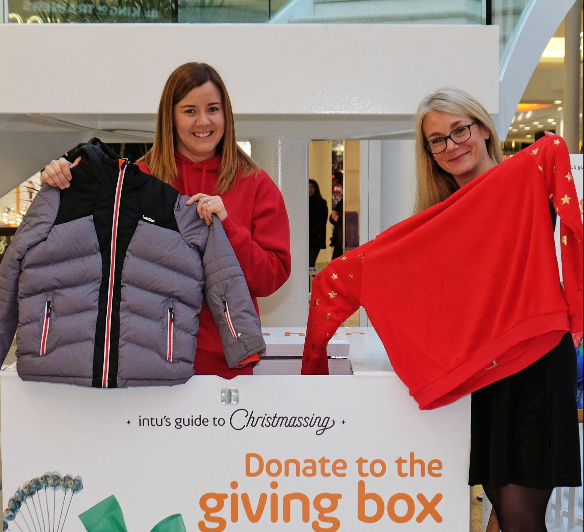 Lynne Gilday of the Back to School Bank Paisley charity and Lydia Brown, from intu Braehead.