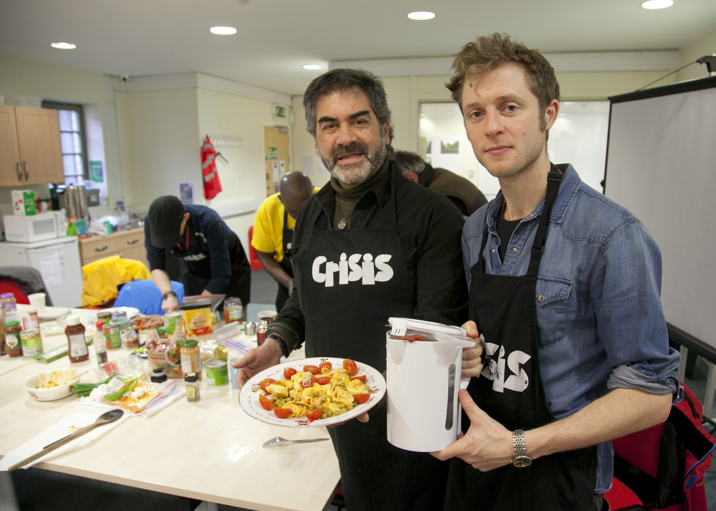 Will Golding, of homeless charity Crisis, on right, with Roberto Ormino-Soto, who is living in temporary accommodation, at a kettle-cooking class (Alistair Linford)