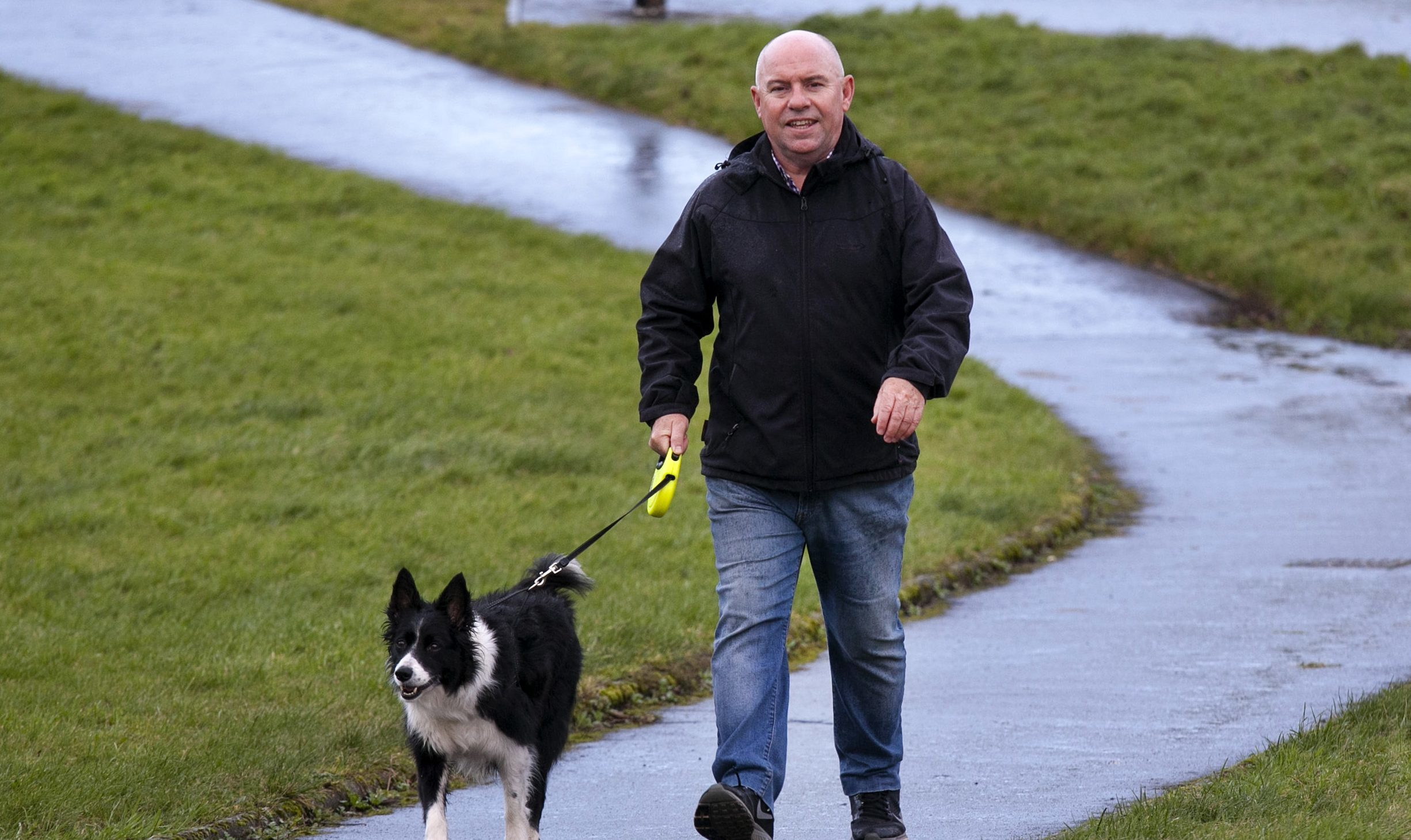 David Halcrow out walking his dog 3 weeks after a partial knee replacement (Alistair Linford)