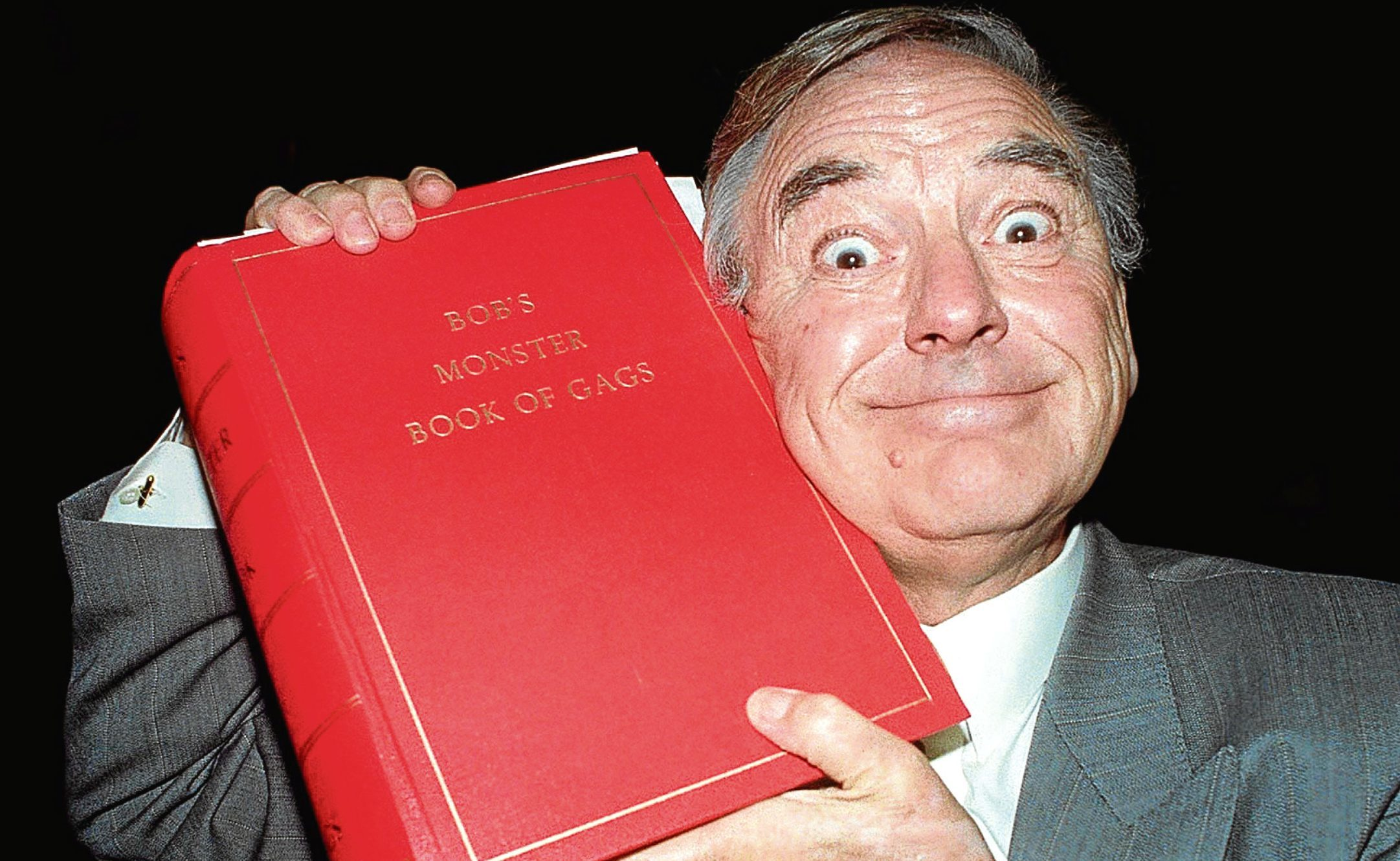 Bob with one of his priceless joke books (David Cheskin/PA)