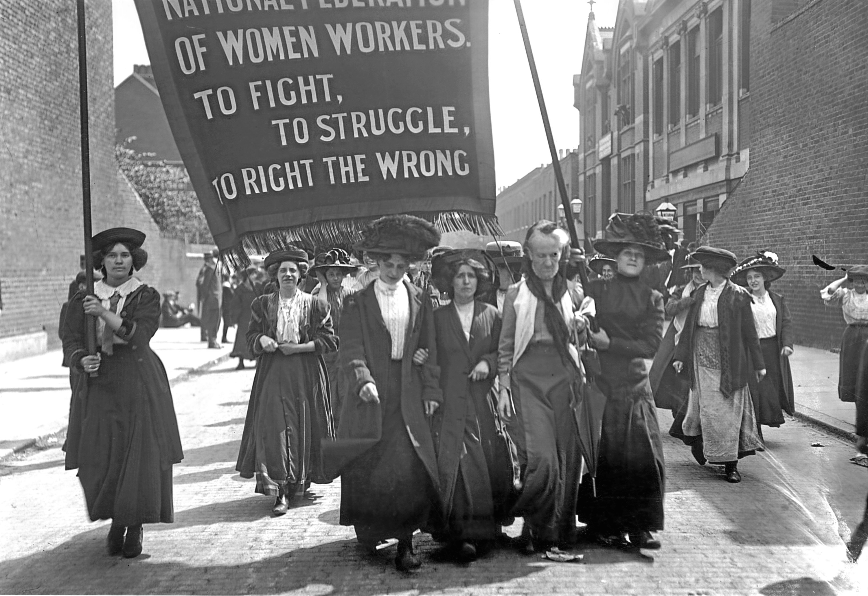 16th May 1911:  British suffragette Charlotte Despard (1844 - 1939) (wearing a white waistcoat) heads a march of the National Federation of Women Workers through Bermondsey in South London.  (Topical Press Agency/Getty Images)