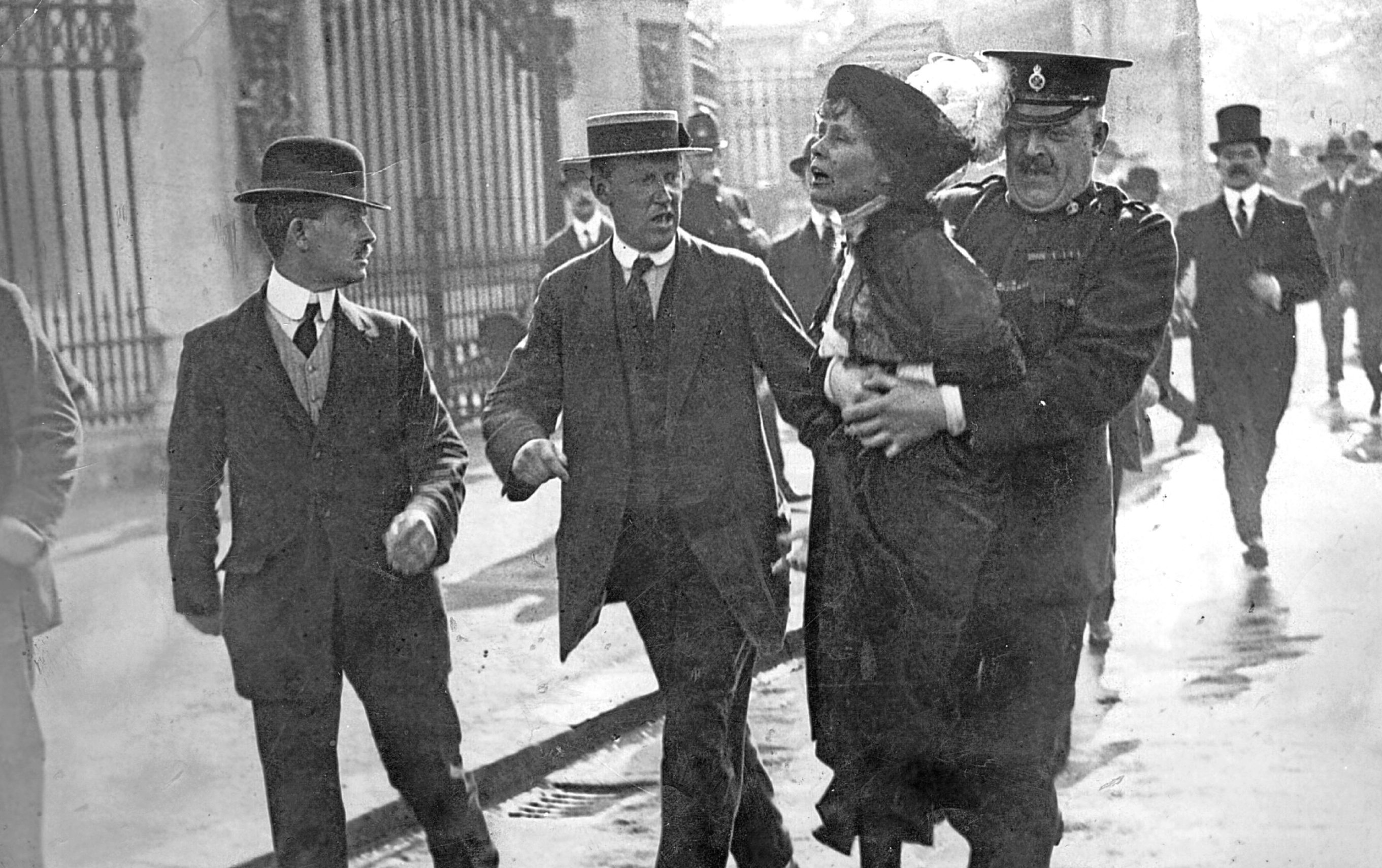 Emmeline Pankhurst is arrested and carried away at a march (Jimmy Sime/Central Press/Hulton Archive/Getty Images)