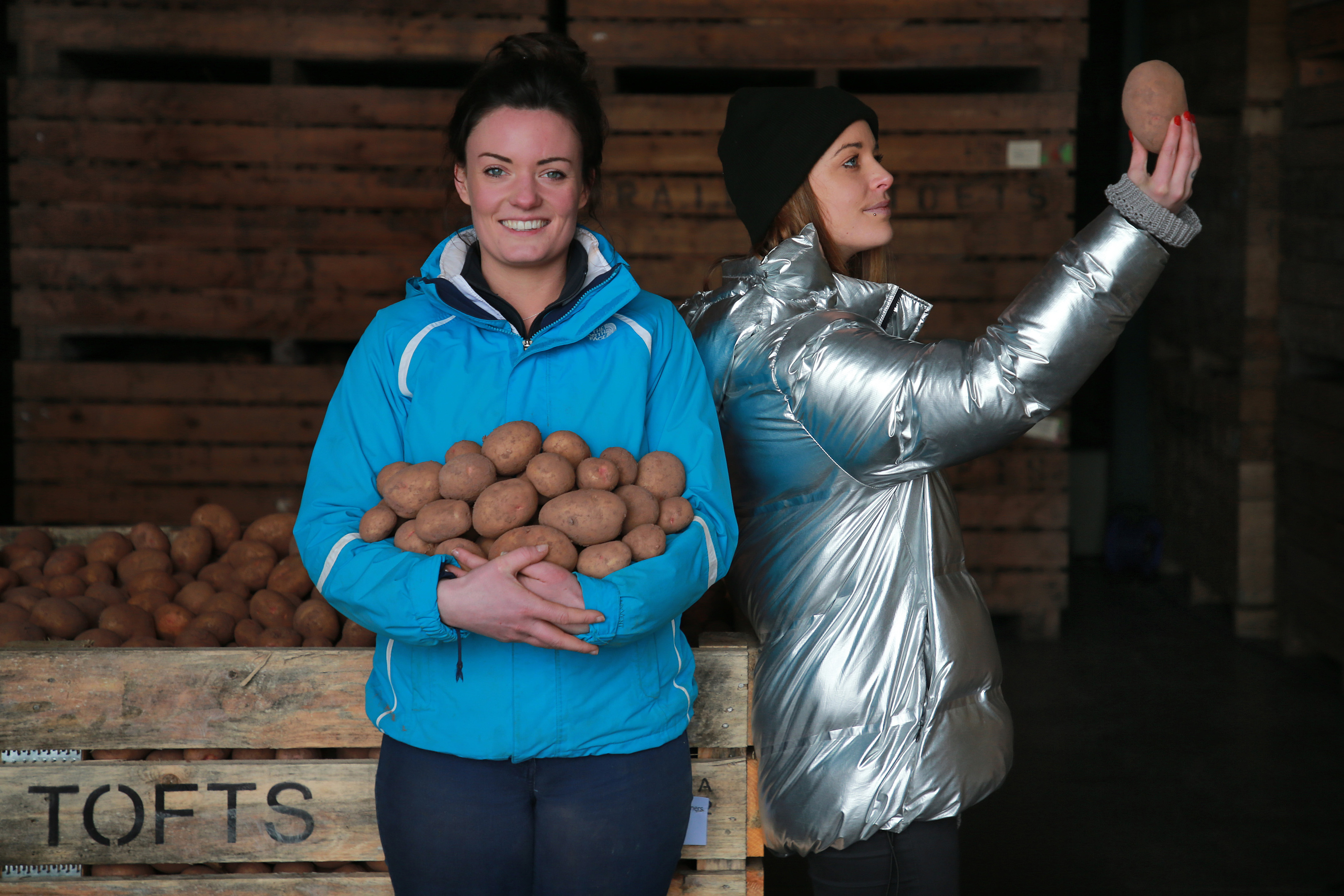 Cat Hepburn, spoken word artist, visits Sarah Dagg, a young potato farmer, to get inspiration about the effort that goes into growing potatoes, often destined for the bin (Stewart Attwood Photography / Zero Waste Scotland)