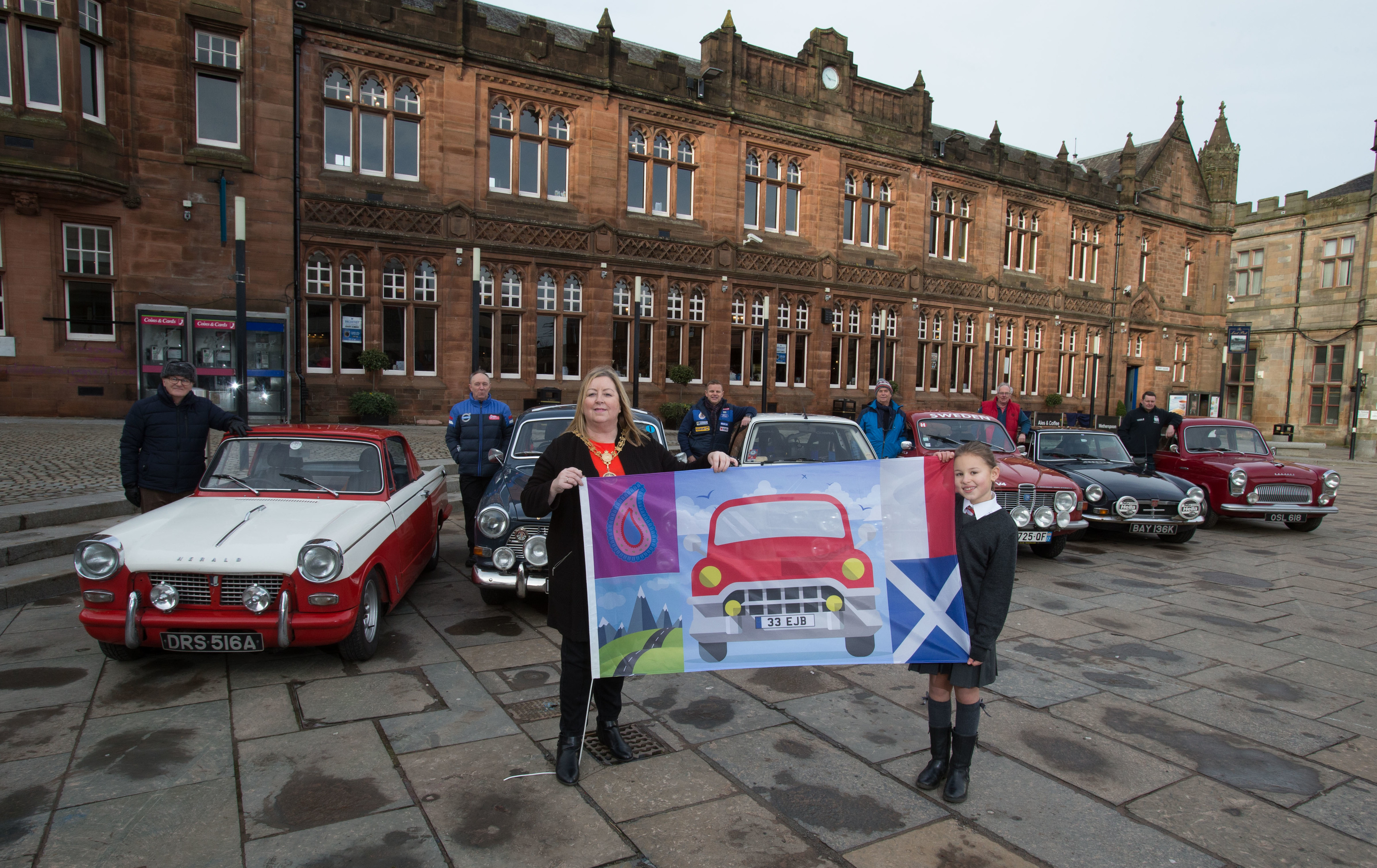 Renfrewshire Provost Lorraine Cameron and Primary 6 pupil Emilia Kozlowska, who won a Renfrewshire-wide school competition to design the flag to be used to wave off the drivers