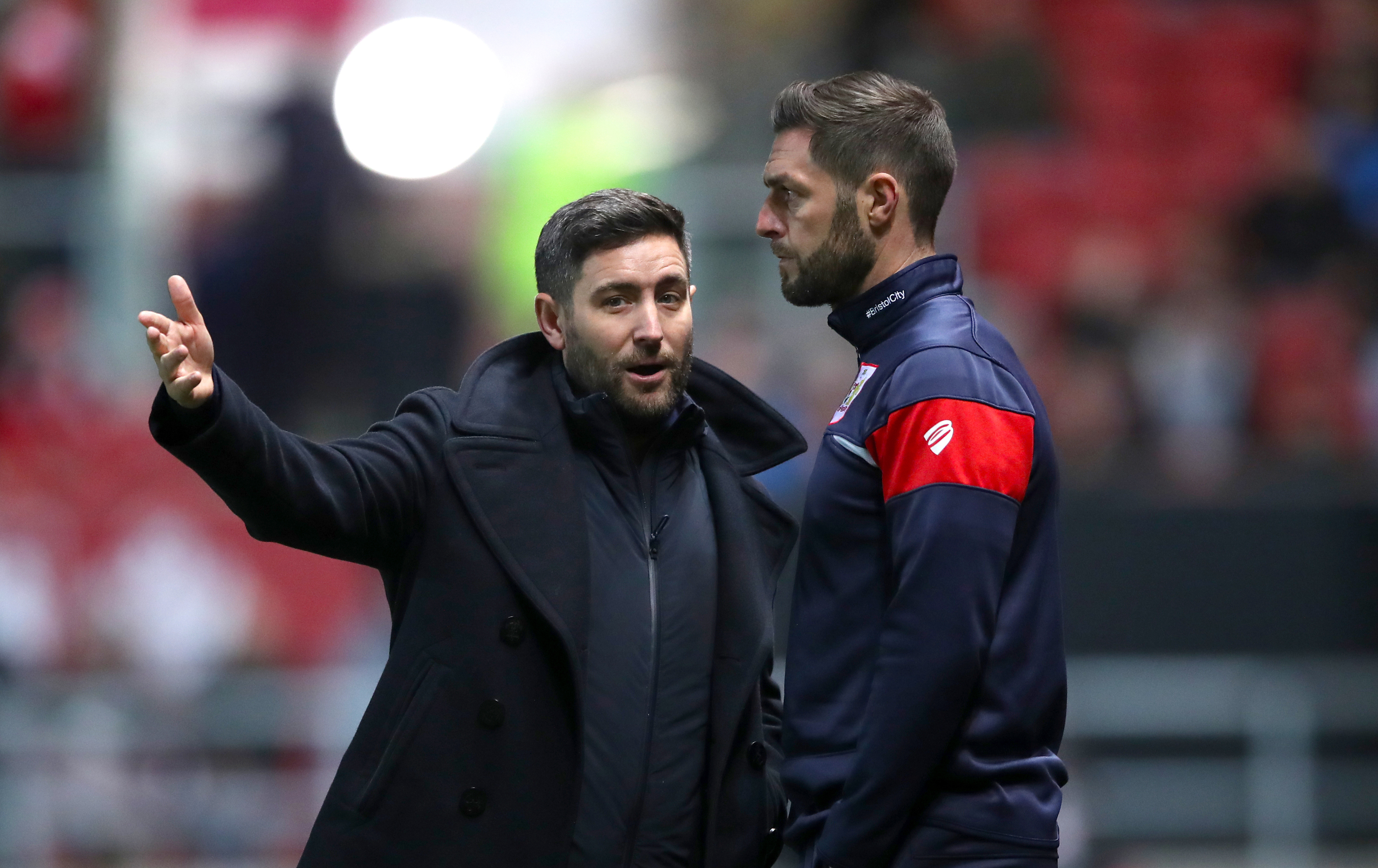 Bristol City Manager Lee Johnson (left) speaks with Assistant Head Coach Jamie McAllister (PA)