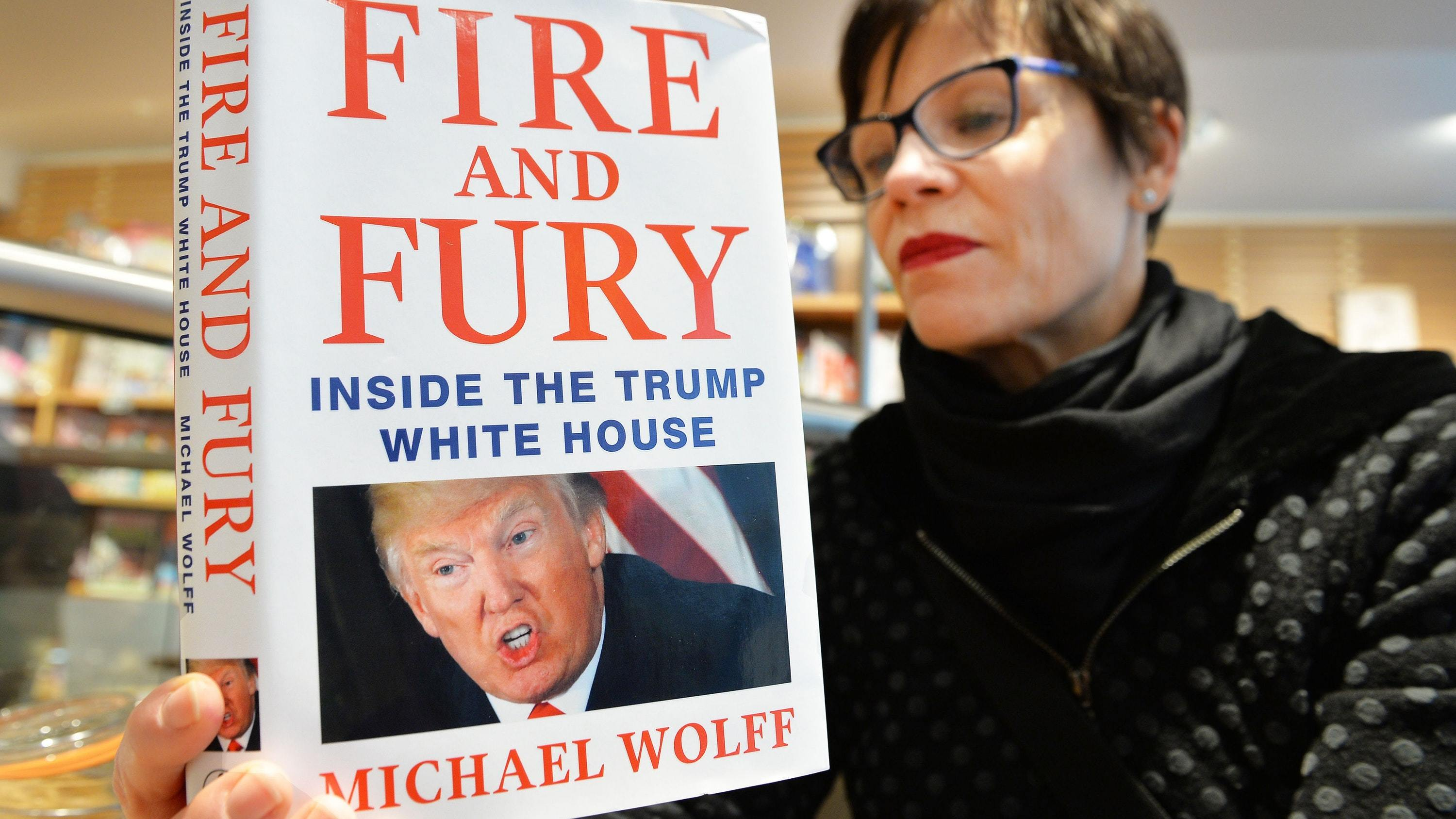 Asa Kallen-Lindh, from Sweden, reads Fire And Fury in the Waterstones store in Piccadilly (John Stillwell/PA)
