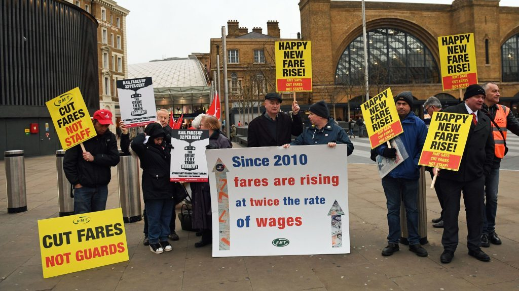 Campaigners protest outside King's Cross station (Stefan Rousseau/PA)