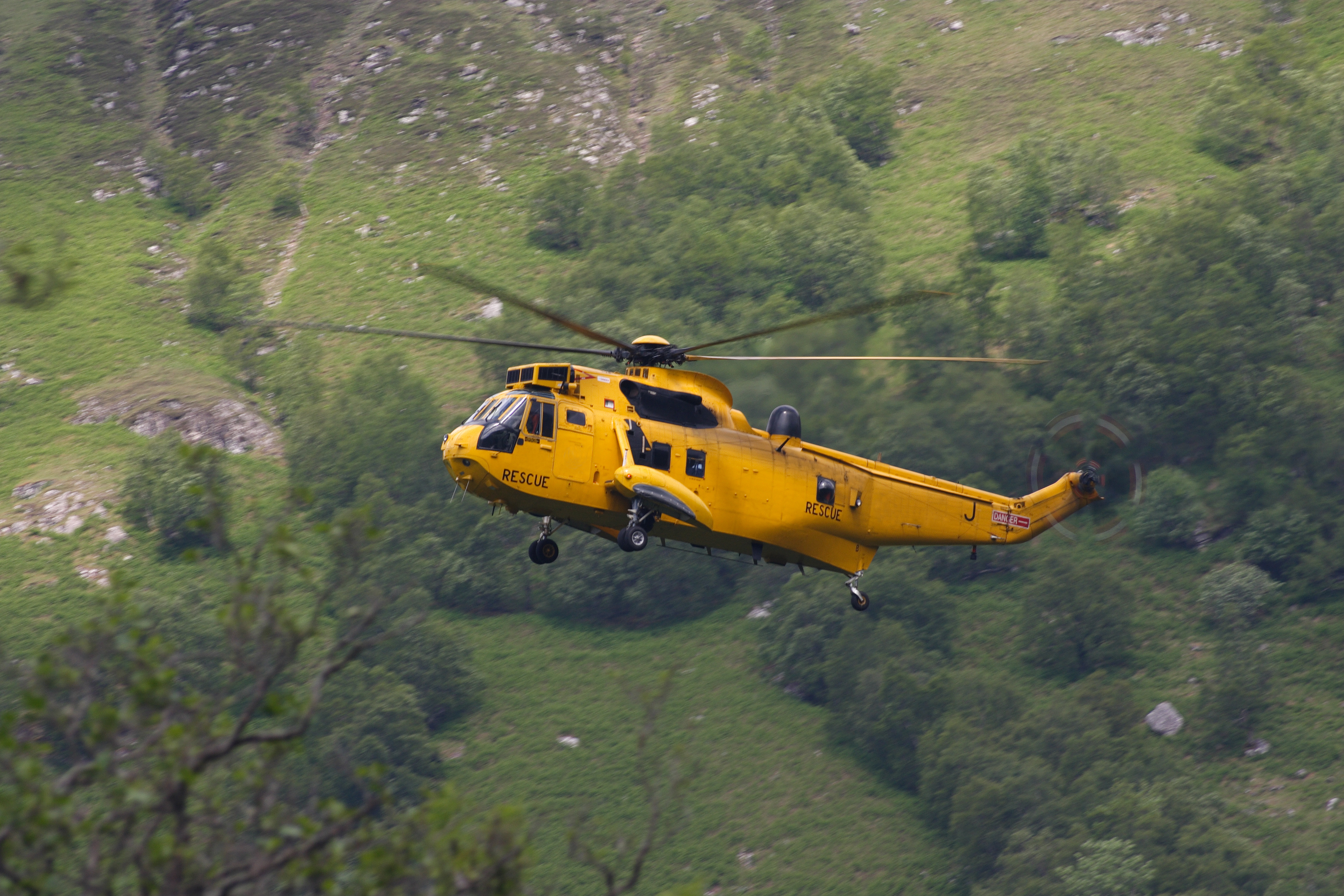 RAF Mountain rescue helicopter flying in the Scottish Moutains (Getty Images/iStock)