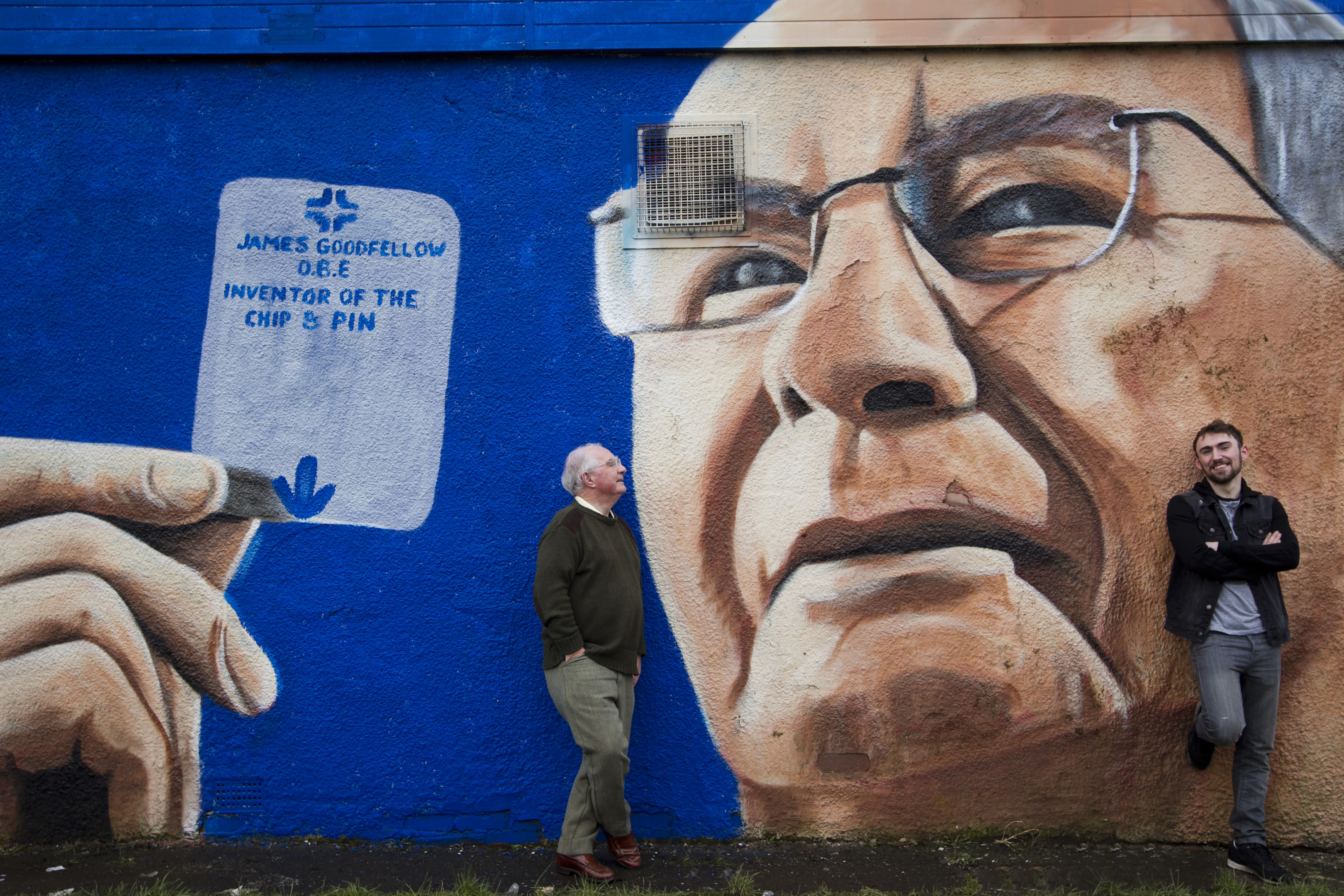 Graffiti artist Shaun Deveney, right, created the mural in Paisley in tribute to ATM inventor James Goodfellow, left            (Andrew Cawley / DC Thomson)