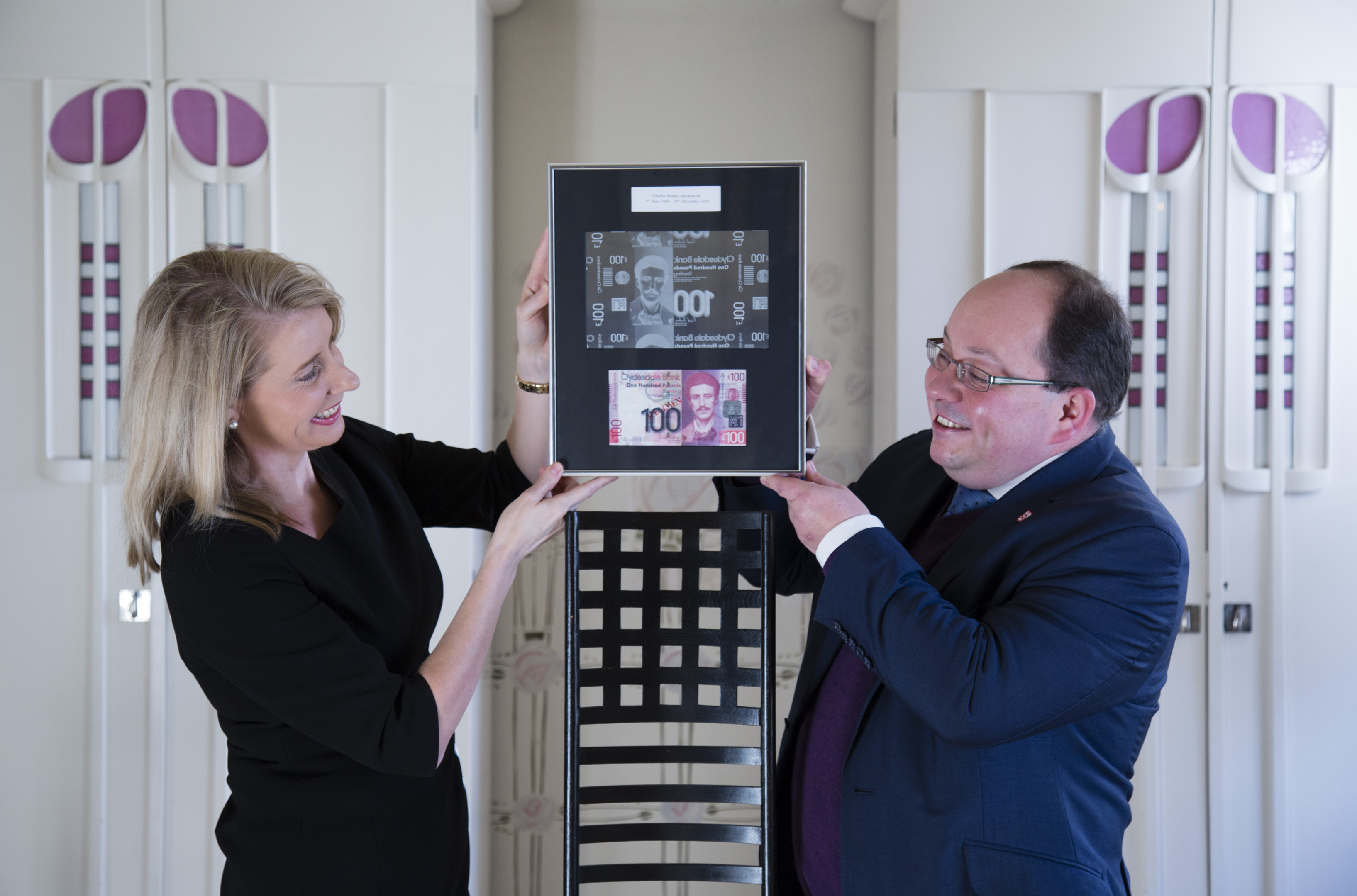 Debbie Crosbie of The Clydesdale Bank with Richard Williams of The National Trust for Scotland at The Hill House in Helensburgh, designed by Charles Rennie Mackintosh, as an urgent fundraising appeal has been launched to raise £1.5 million to build a protective box around the crumbling architectural masterpiece. (Martin Shields/PA Wire)