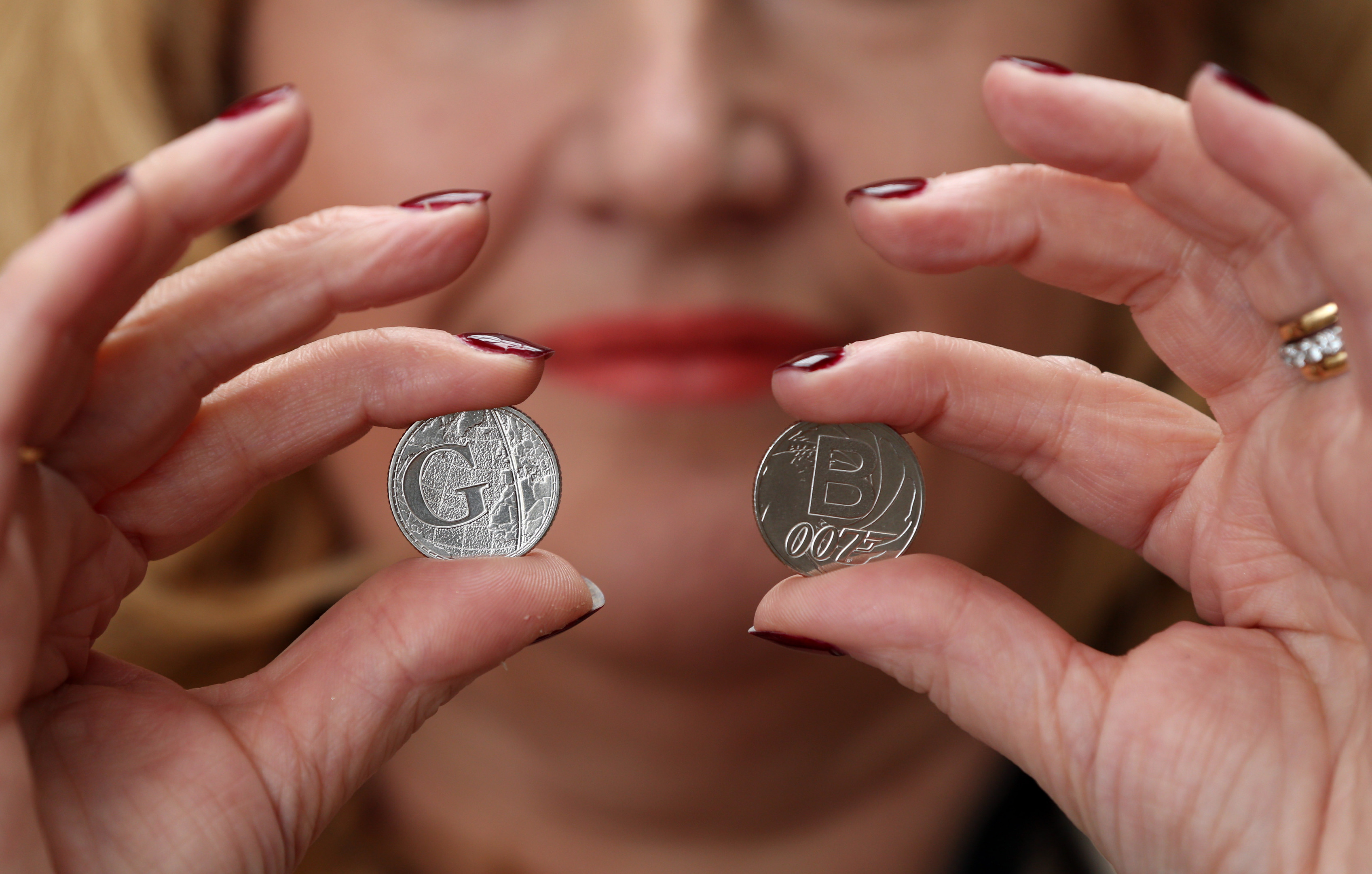 Royal Mint CEO Anne Jessopp holds two of the 26 brand new 10 pence designs that will appear across the country as part of the 'Great British Coin Hunt', celebrating what makes Britain great. (Jonathan Brady/PA Wire)
