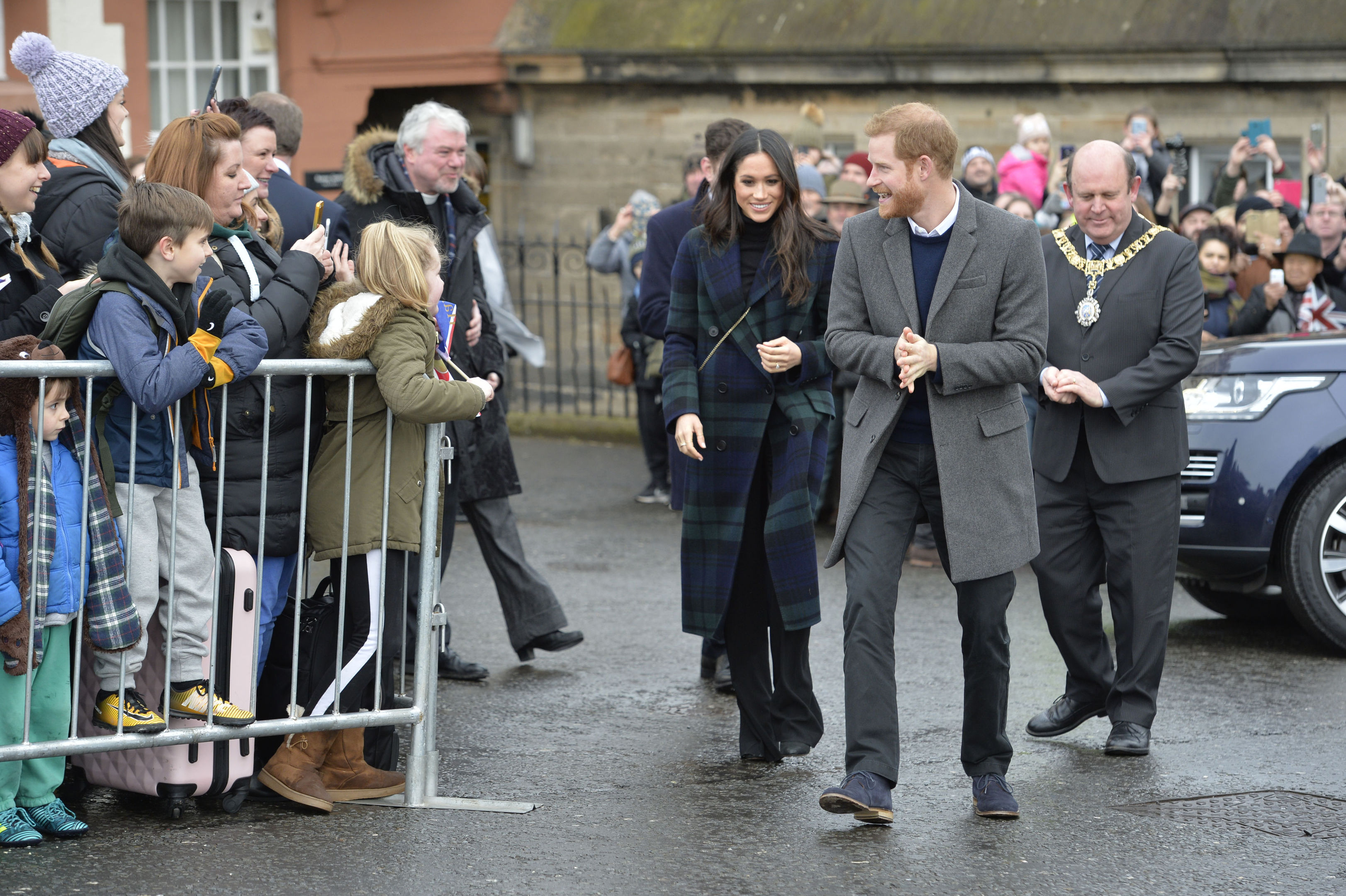 Prince Harry and Meghan Markle during a walkabout on the esplanade at Edinburgh Castle, during their visit to Scotland. (John Linton/PA Wire)