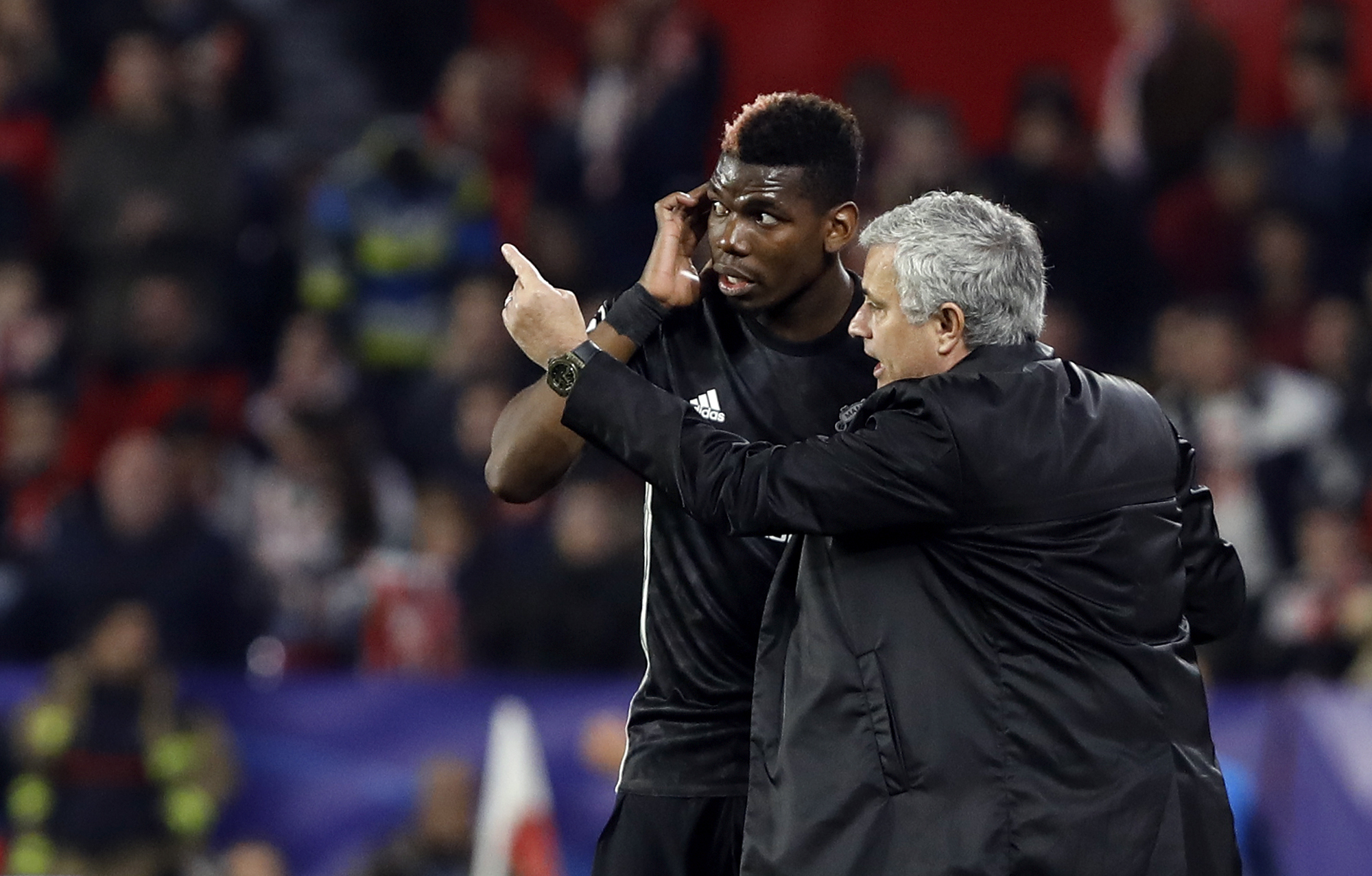 Jose Mourinho talks to  Paul Pogba during last night's Champions League match (AP Photo/Miguel Morenatti)