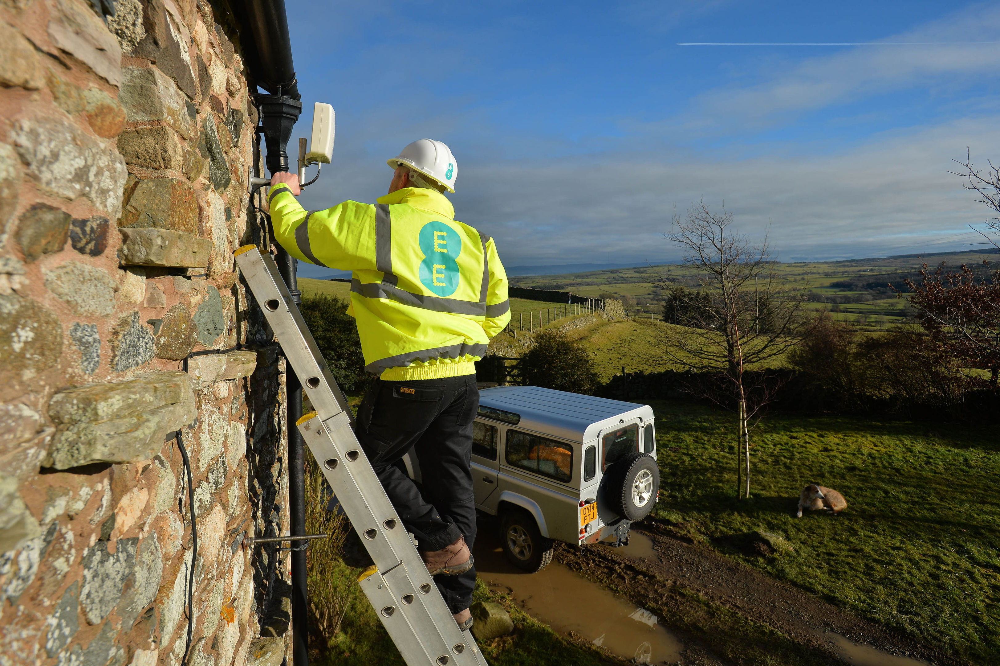 An EE engineer installs a 4G antenna to a home in the Cumbrian North Fells (Mark Runnacles/PA Wire)