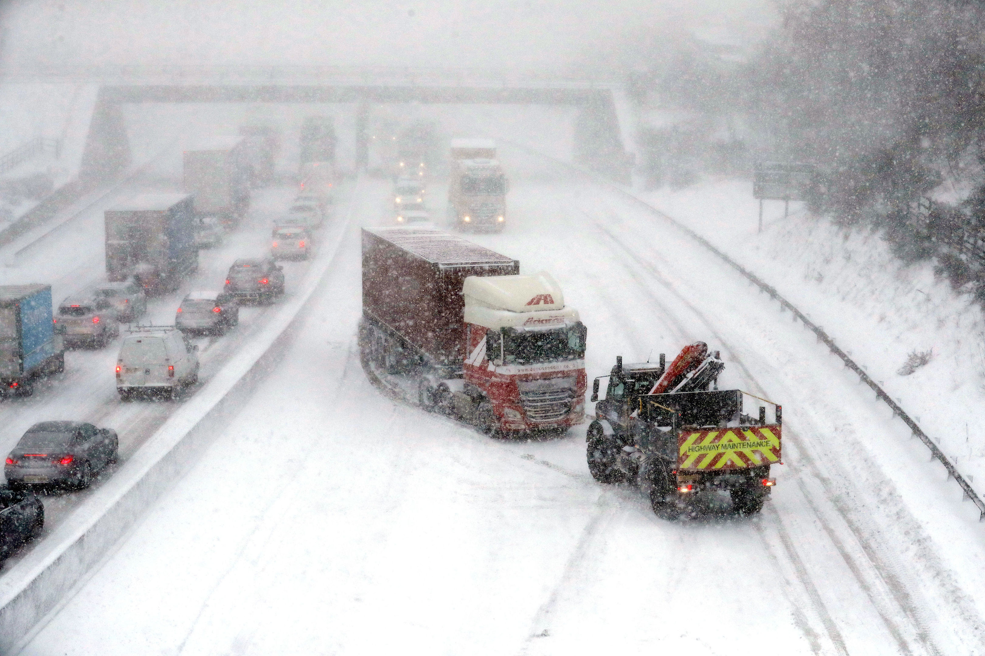 A lorry is pulled off to the side of the road on the M80 at Haggs in Glasgow after getting stuck (Andrew Milligan/PA Wire)