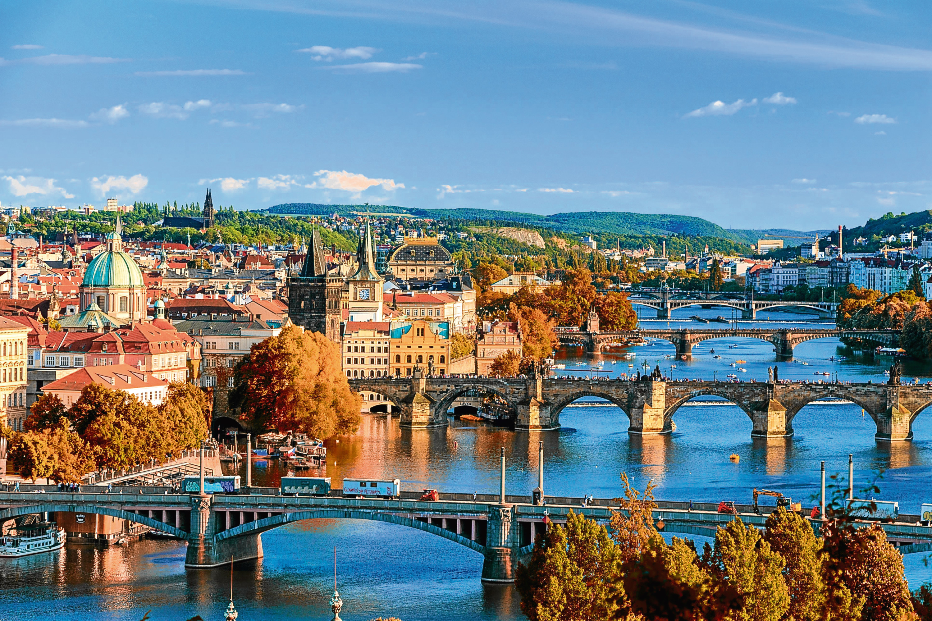 View of the Vltava River and Charle bridge with red foliage, Prague, Czech Republic (Getty Images)