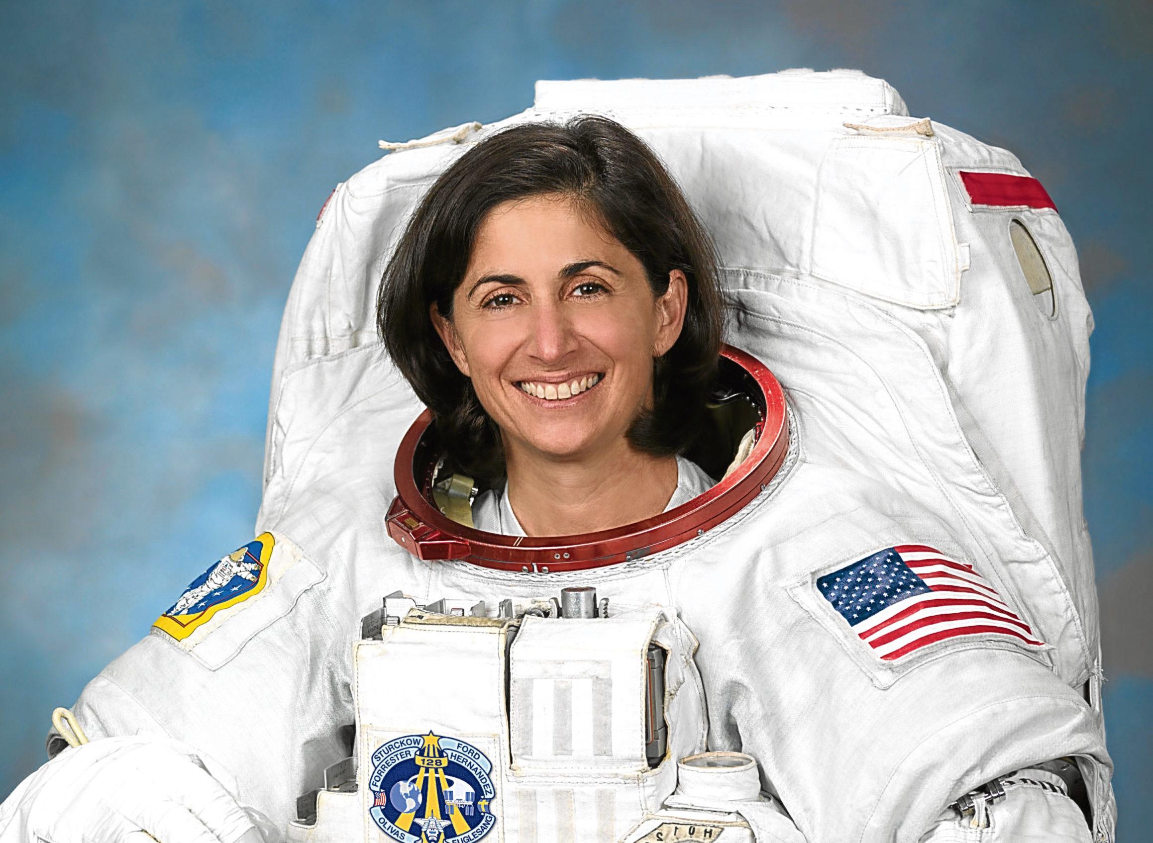 Official Portrait of NASA Astronaut Nicole Stott in an EUM. (Robert Markowitz)