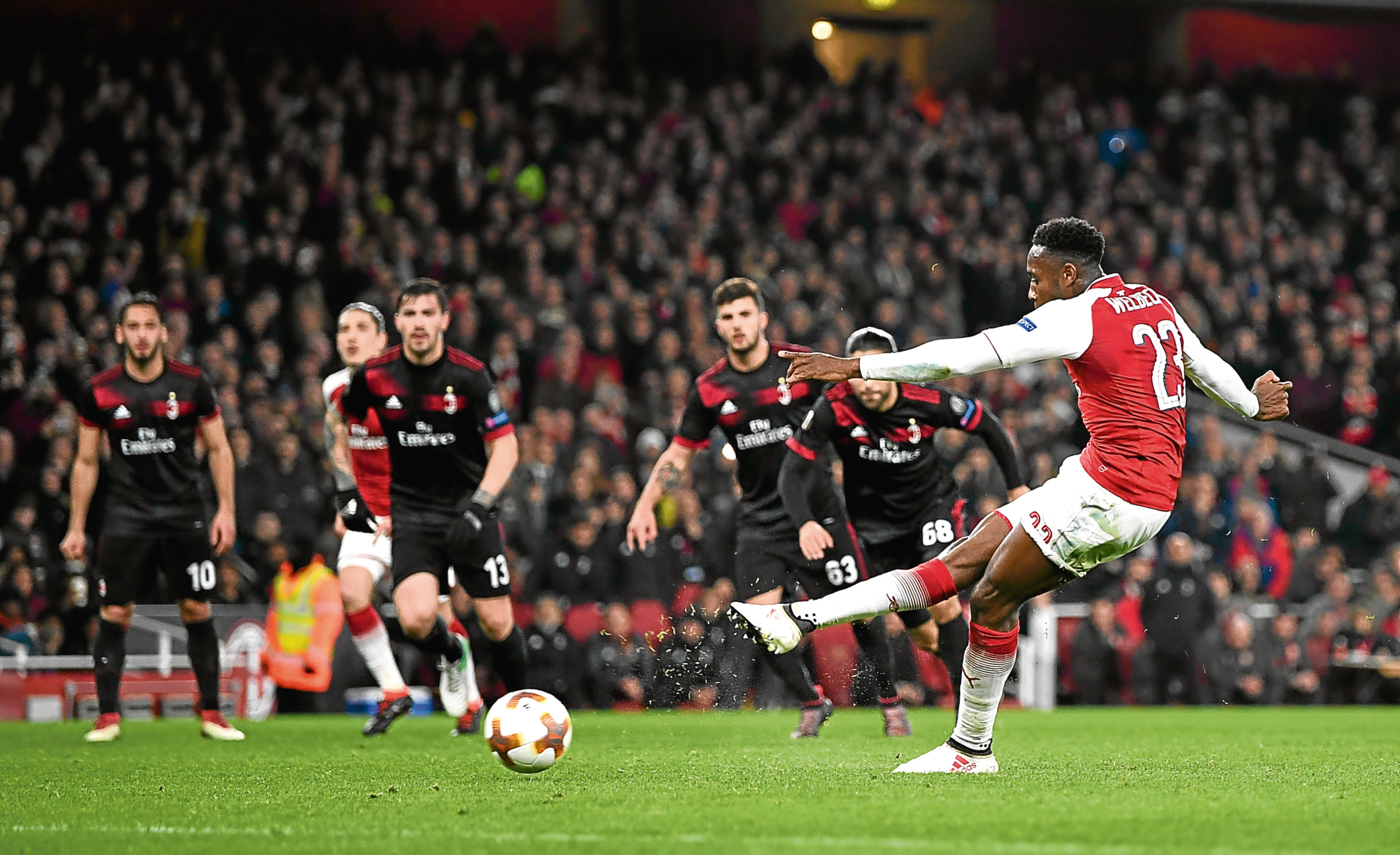 Danny Welbeck scores from the spot against AC Milan last month (Shaun Botterill / Getty Images)