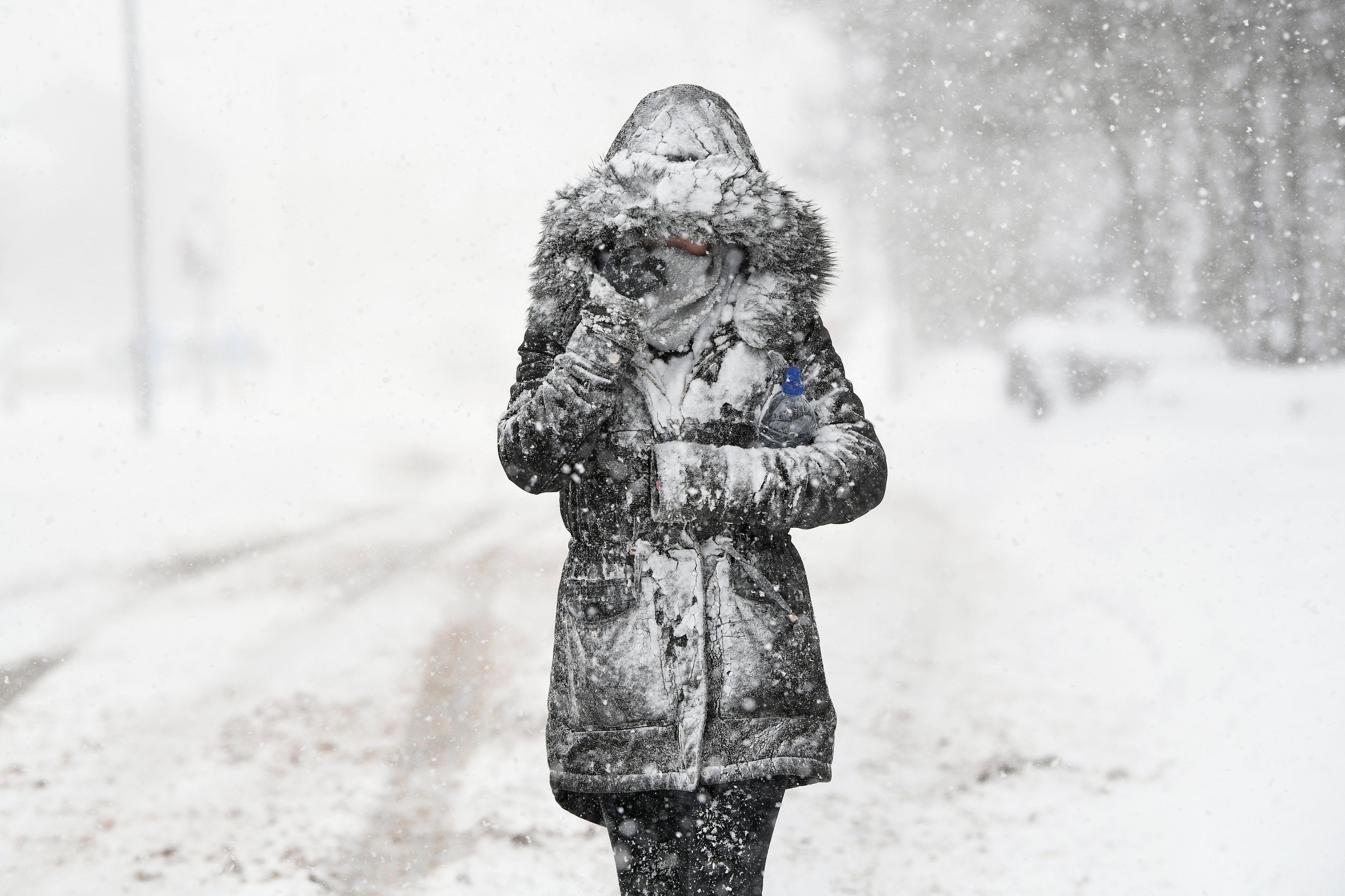 A woman makes her way through the snow on March 1, 2018 in Balloch, Scotland. (Jeff J Mitchell/Getty Images)