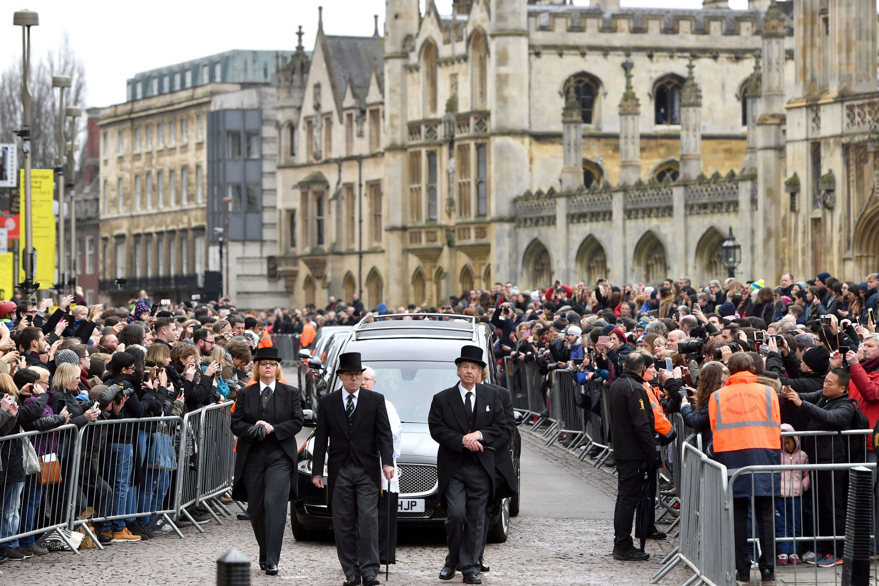 The hearse arrives at University Church of St Mary the Great in Cambridge, as mourners look on (Joe Giddens/PA Wire)