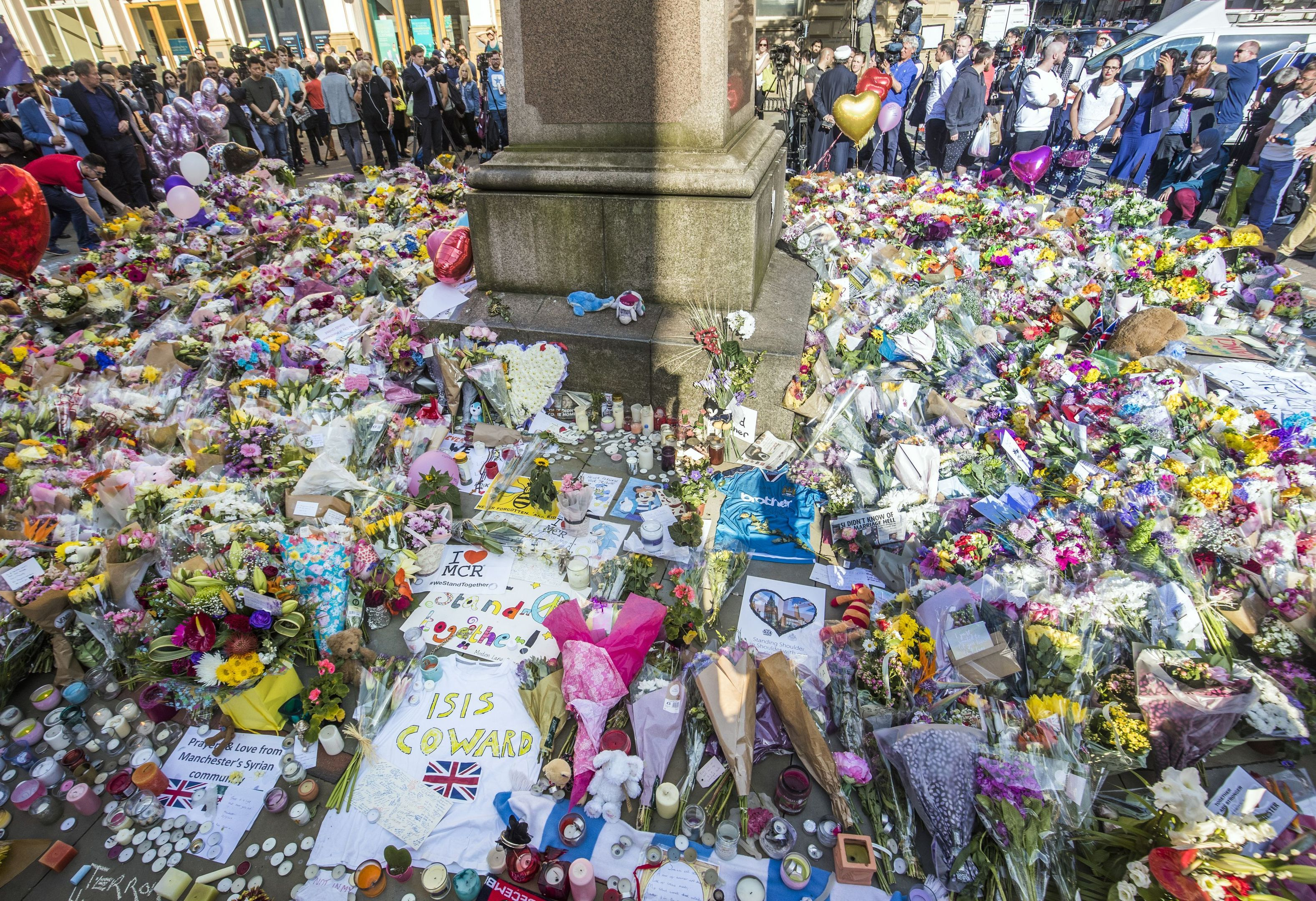 Floral tributes to the Manchester Arena victims (Danny Lawson/PA Wire)