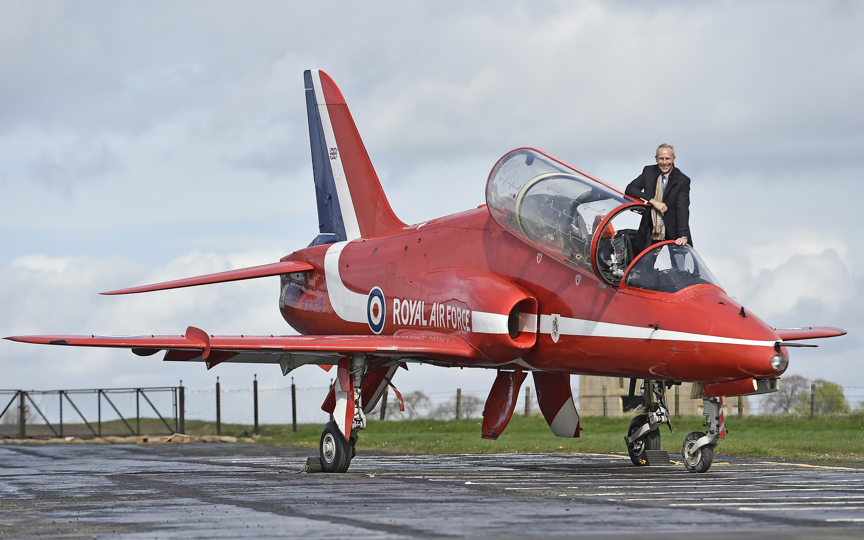Wing Commander Simon Meade is reunited with the Red Arrows Hawk he flew over Edinburgh (Neil Hanna Photography)