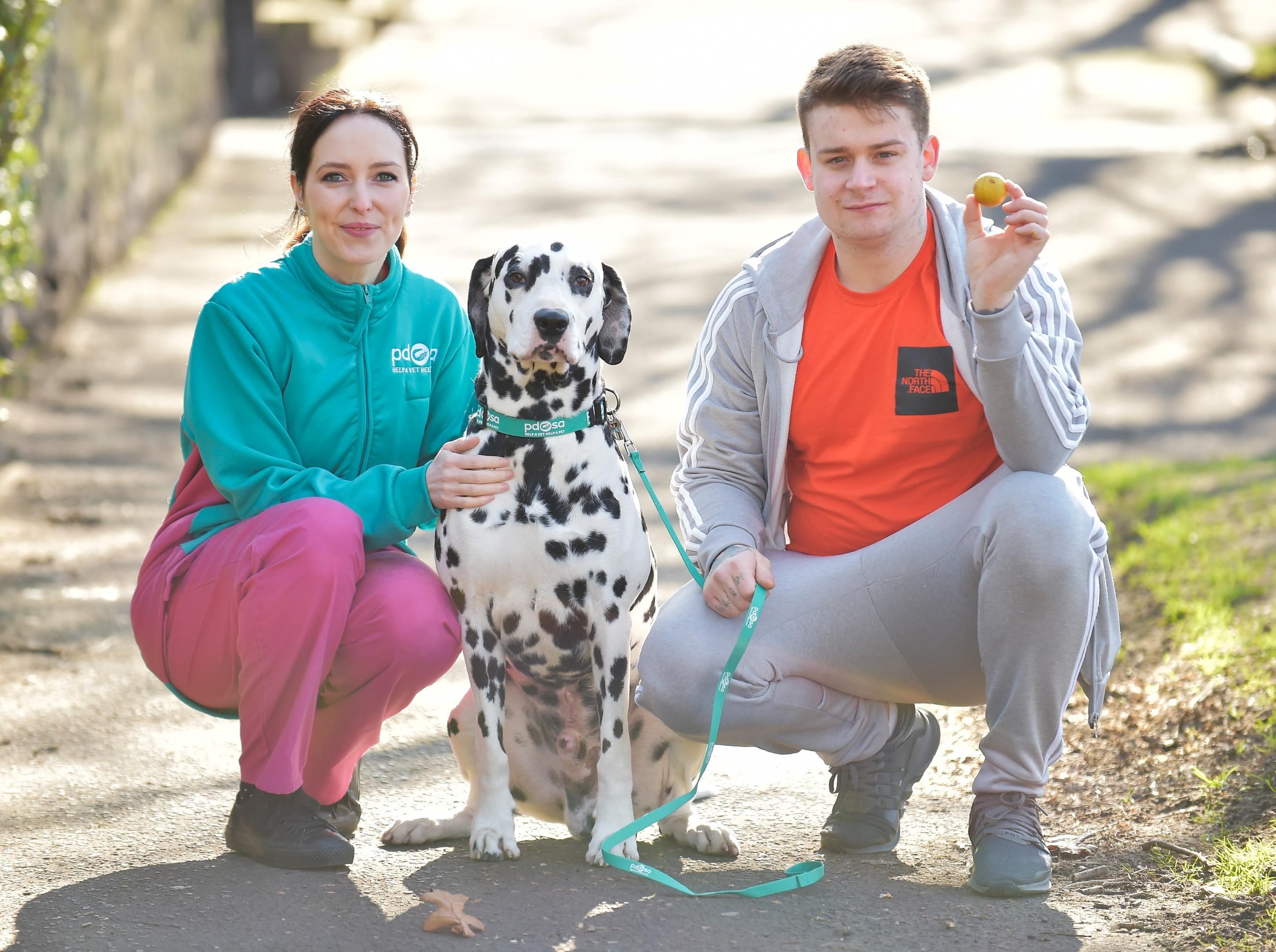 Pongo with owner Jack Harvey and PDSA vet Gemma Hepner (PDSA/PA)