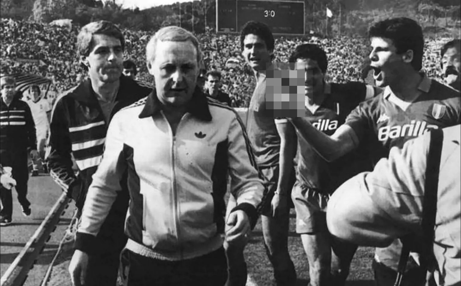 Jim McLean and Walter Smith run the gauntlet of Roma players, including Sebastiano Nela (far right)